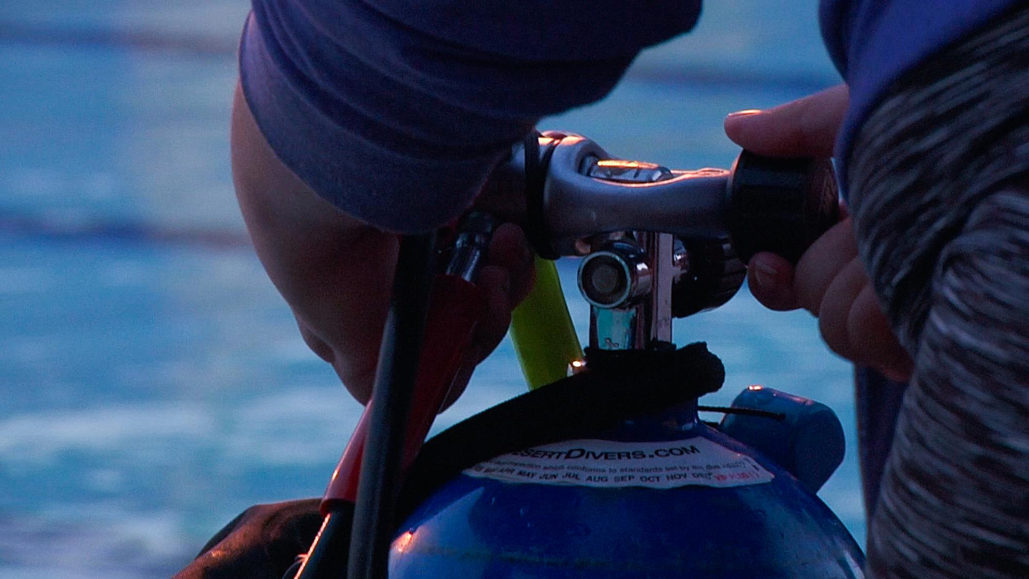 Participants are provided with scuba equipment, including air tanks, to complete the classes.