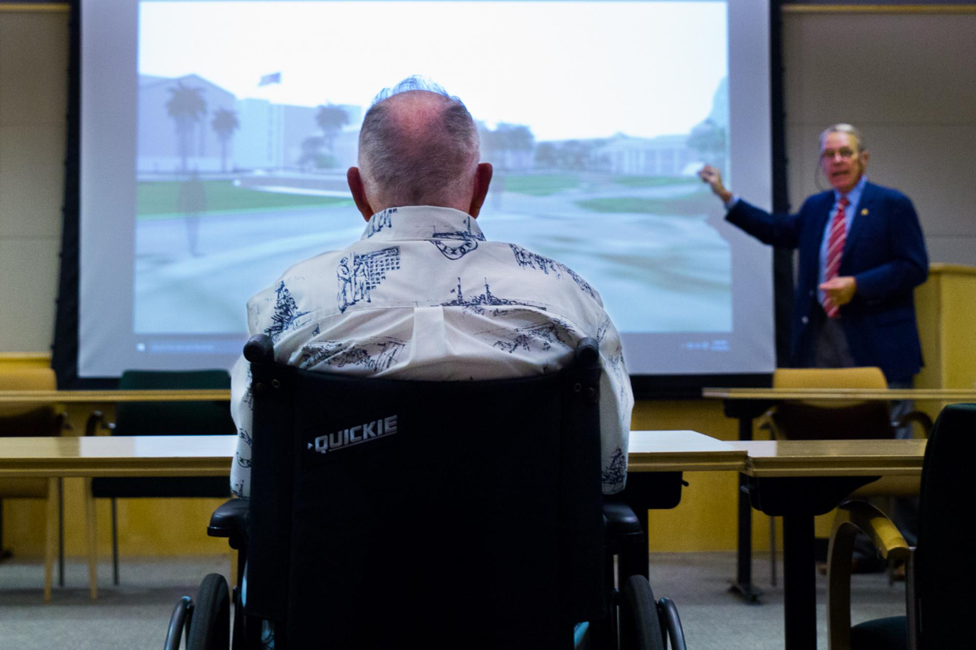 Bill Westcott presents architectural plans for the USS Arizona Mall Memorial as Lauren Bruner, a USS Arizona survivor, listens.
