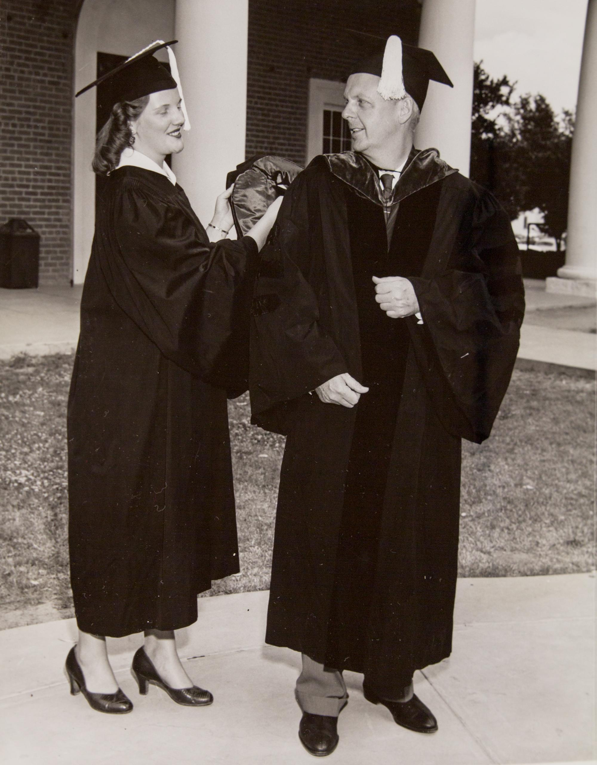 In 1958, Illinois Gov. William G. Stratton gets help adjusting his academic hood from his daughter, Sandra Jane. Both received degrees at the UA's 63rd Commencement. The governor, who graduated from the UA in 1934, received the honorary degree of Doctor o