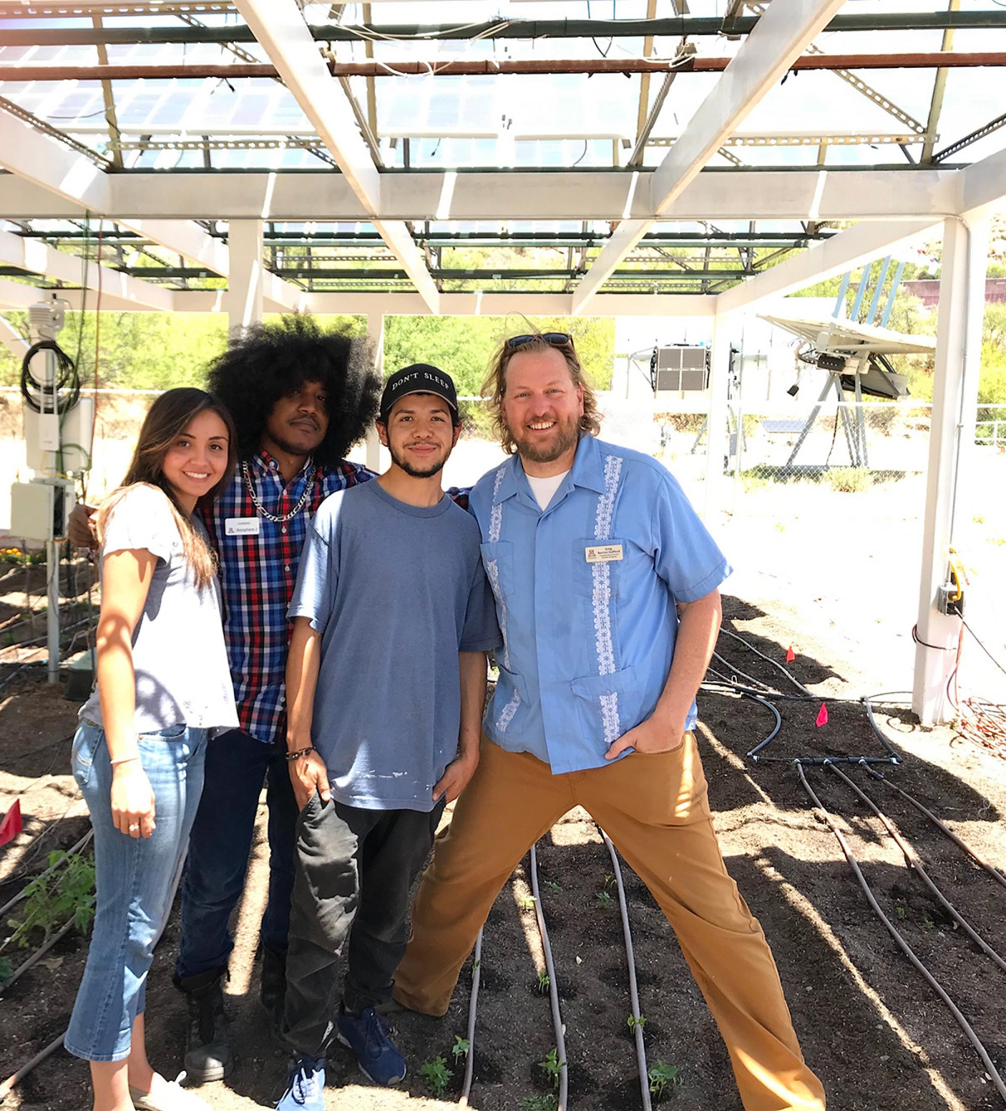 From left: University of Arizona students Alyssa Salazar, Leandro Phelps-Garcia and Isaiah Barnett-Moreno conducted the agrivoltaics research at the Biosphere 2 under the guidance of associate professor Greg Barron-Gafford.