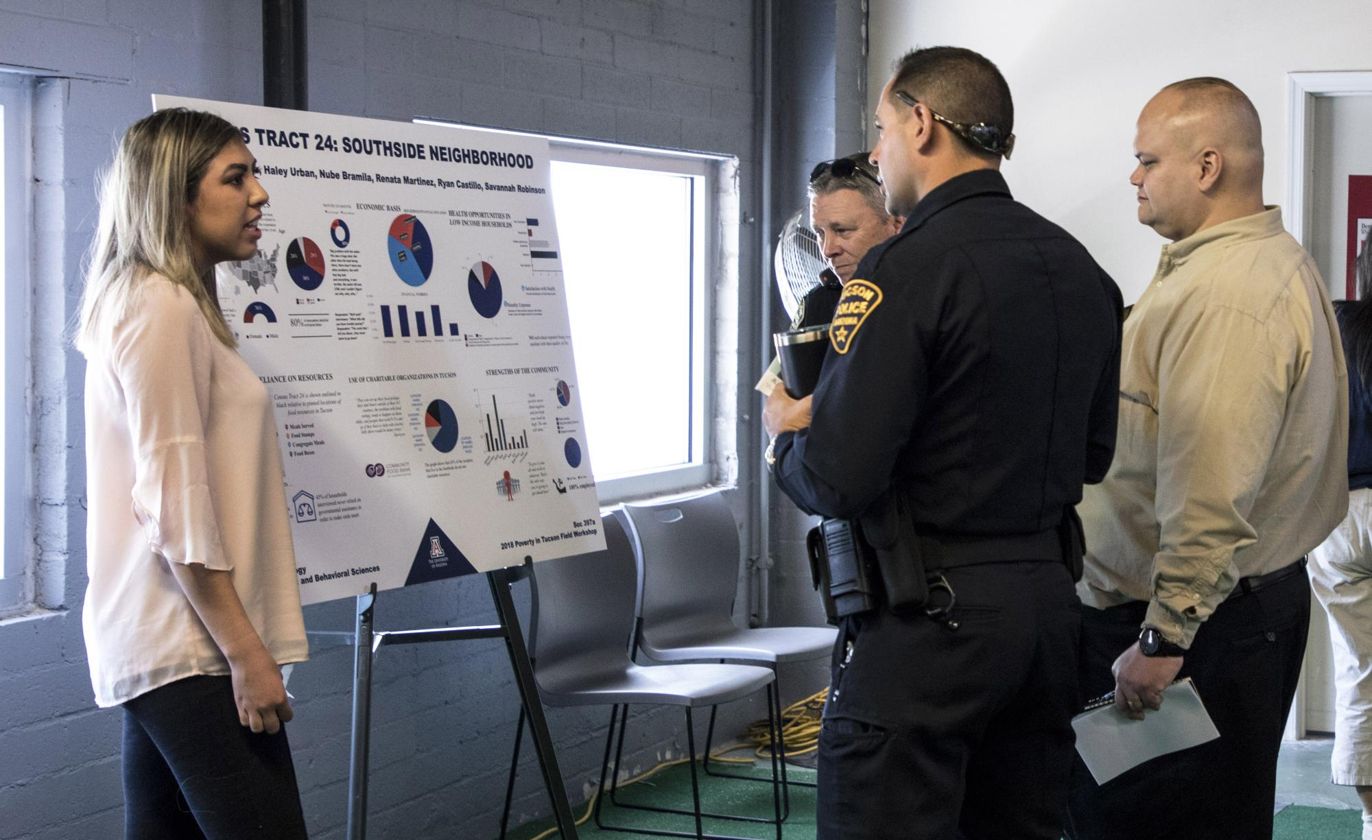 Several Tucson police officers and firefighters attended the poverty forum. Students in next year's class will collaborate with the Tucson Fire Department's TC-3 program, a collaborative community care program.