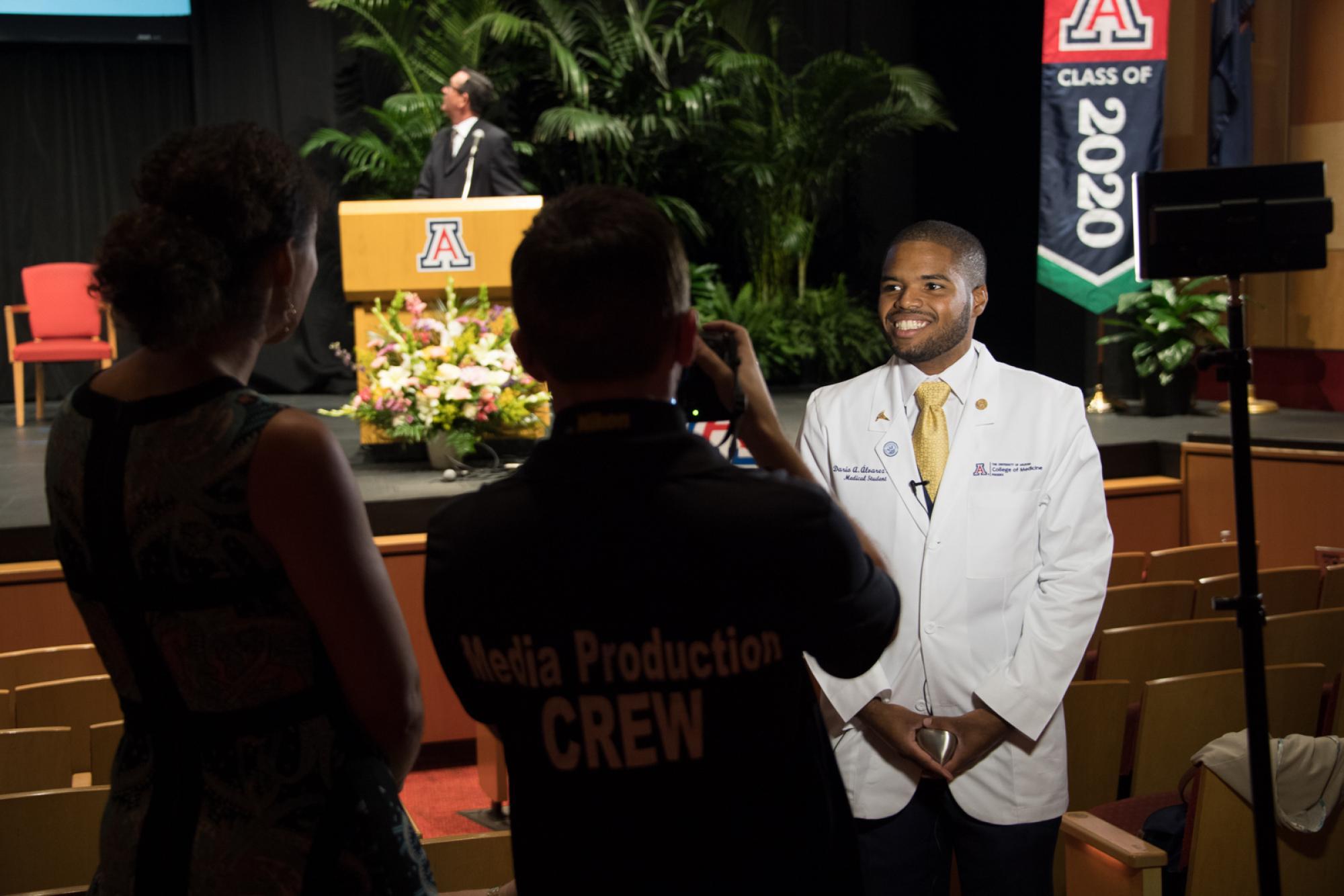 Dario Alvarez, who graduated from the Pathway Scholars Program, is interviewed before the ceremony.