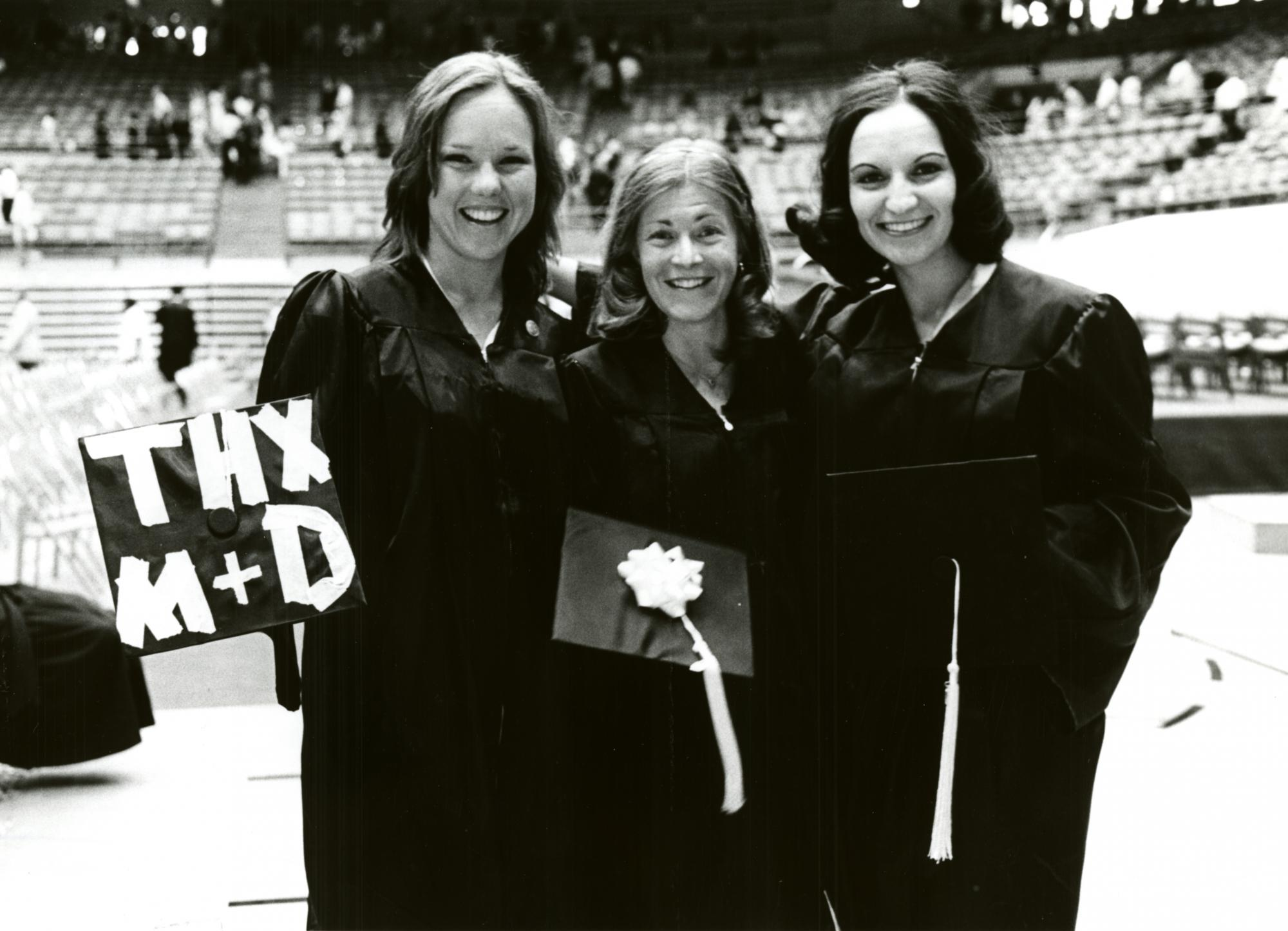 UA graduates celebrate Commencement in 1976. The tradition of adorning caps with personal messages began in the 1960s.