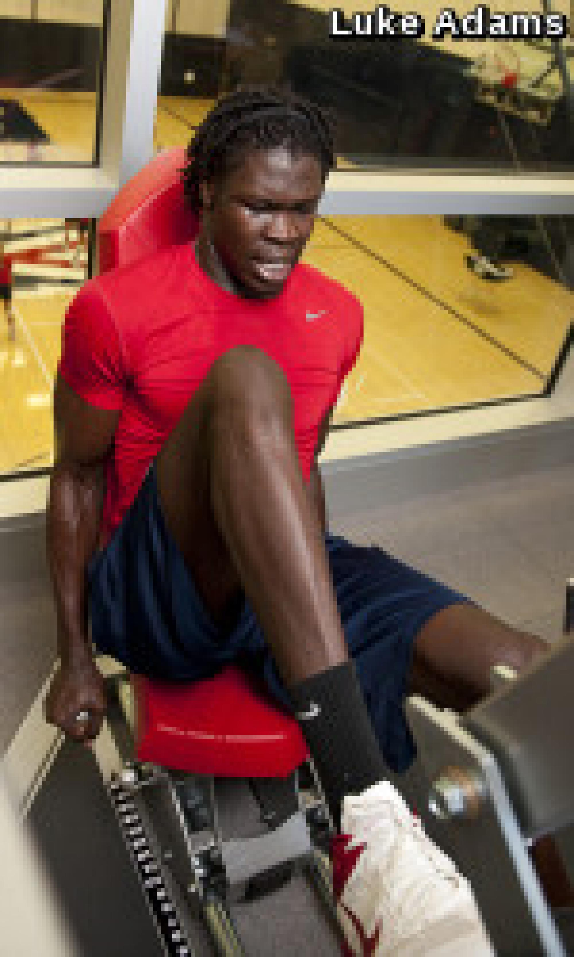 Forward Angelo Chol works out in the Cole & Jeannie Davis Strength and Conditioning Center.