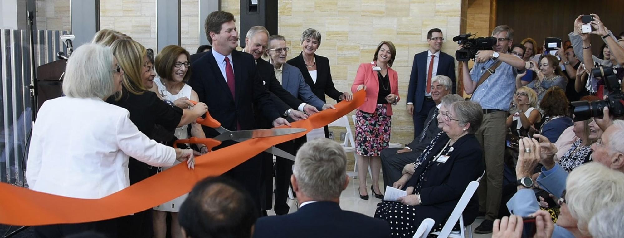 Several University of Arizona and hospital administrators, along with elected officials and other dignitaries, attended the ribbon cutting.