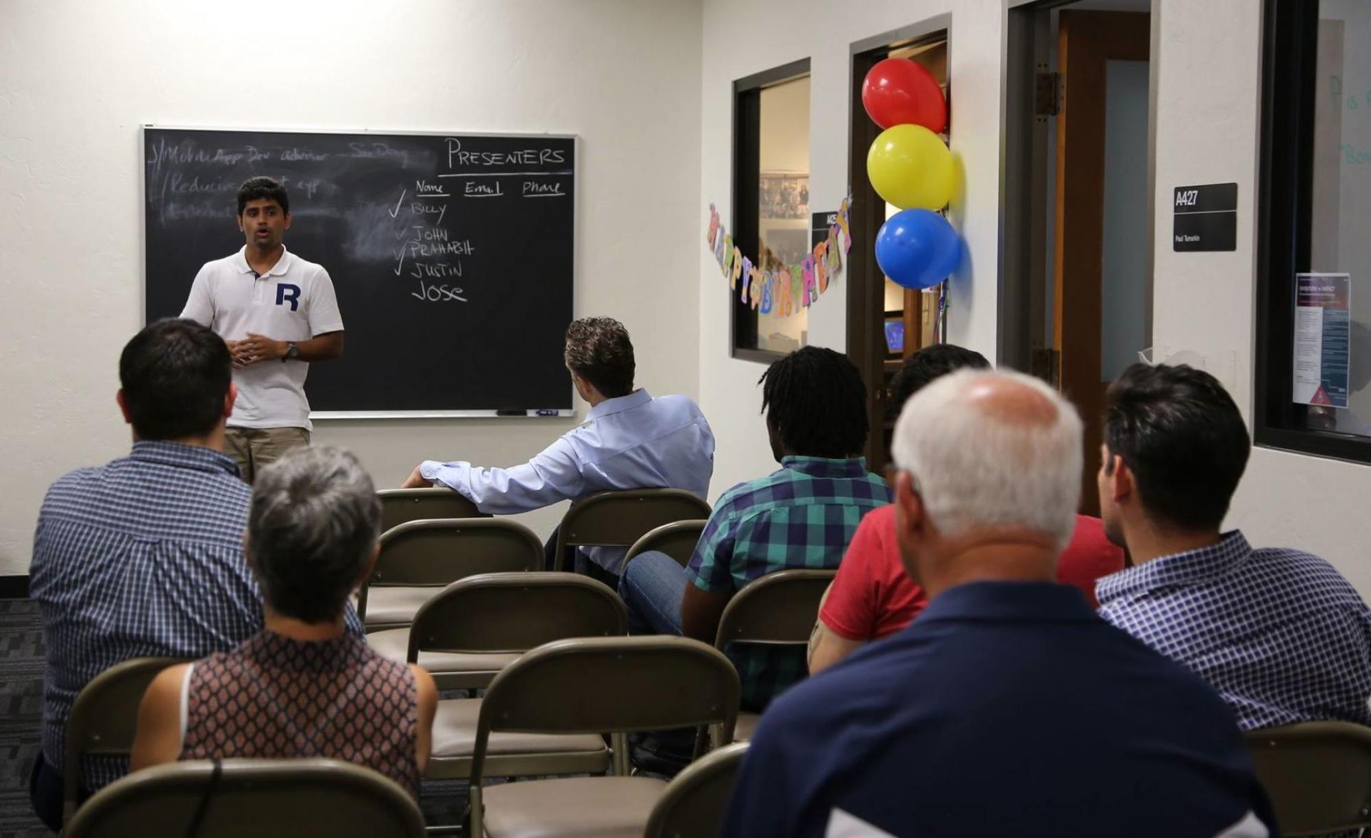 Praharsh Srinivasula, a first-year master's student studying computer science, pitches his idea for a new organic food tracking app.