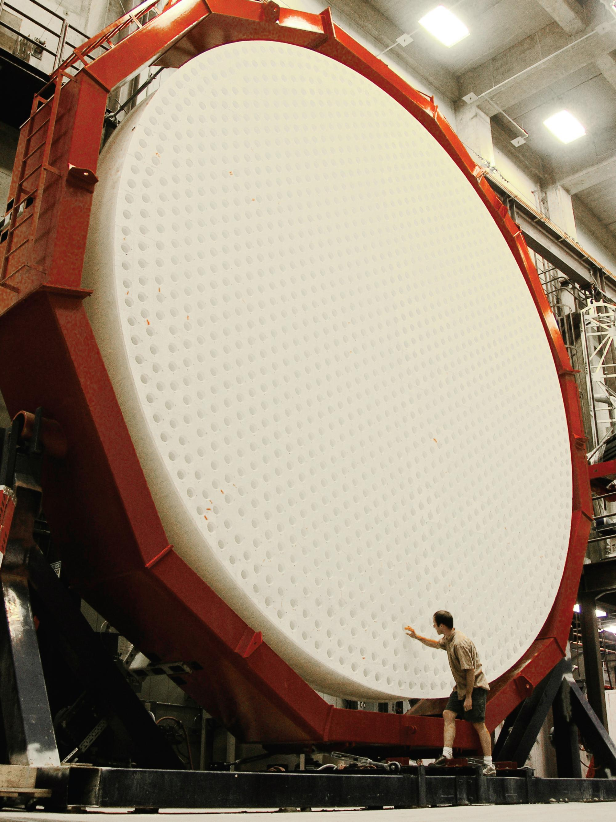The first of seven mirrors for the Giant Magellan Telescope after removal from the furnace. The back surface of the mirror is shown here during an inspection of the holes used to ventilate the mirror during operation in the telescope.