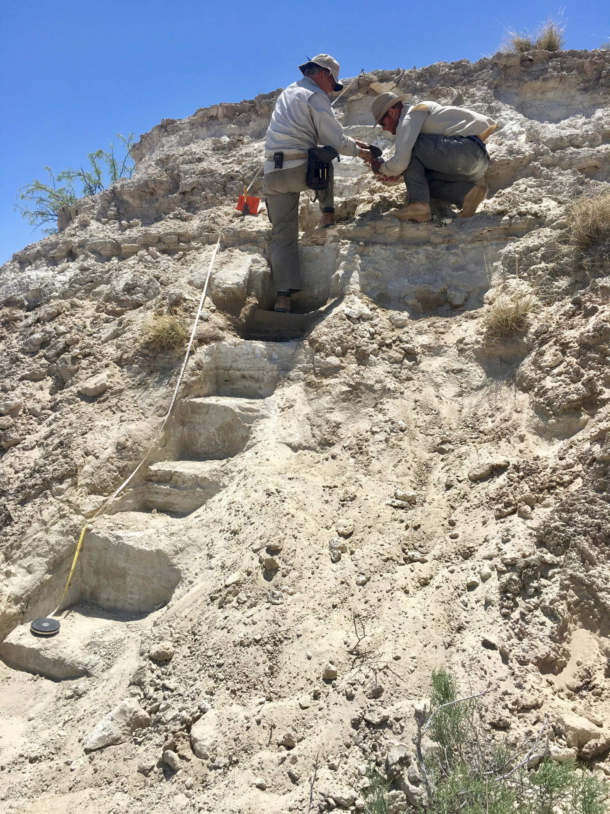 UA professor Vance Holliday  and UA doctoral student Brendan Fenerty work on the section of exposed lake deposits at New Mexico's White Sands National Monument.