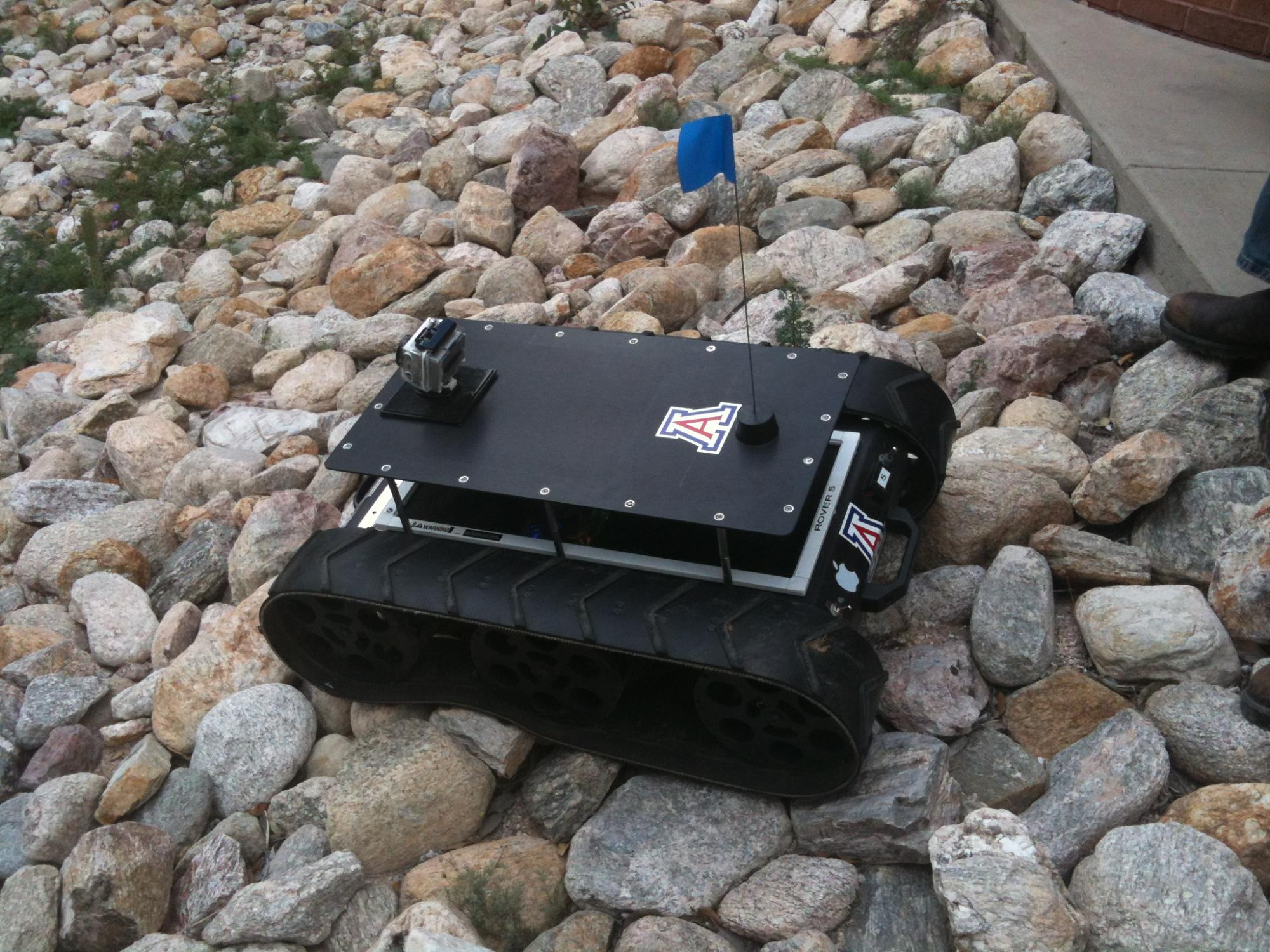 With on-board cameras and a laser range finder, this prototype of an autonomous rover is capable of avoiding obstacles and homing in on target structures.