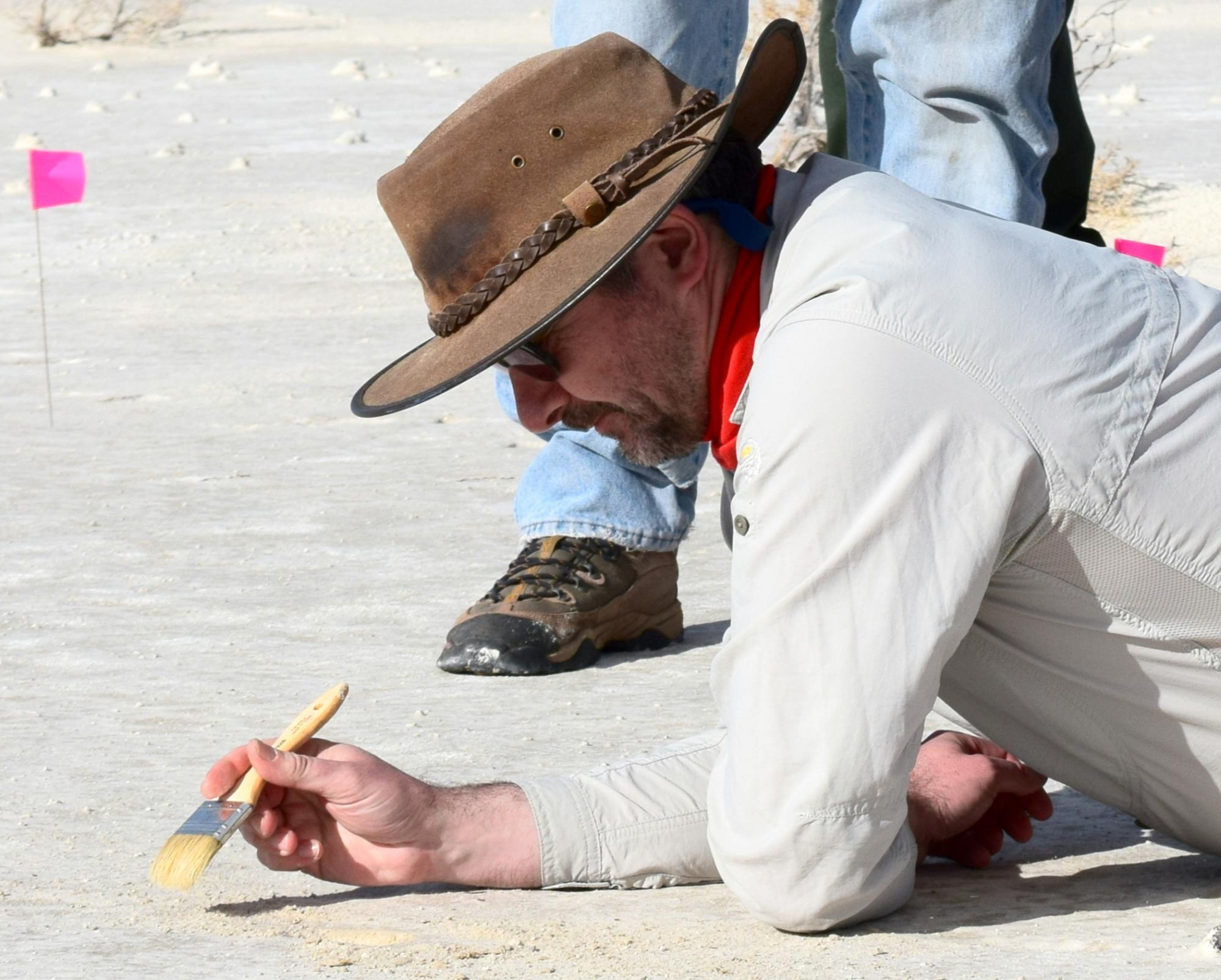Professor Matthew Bennett, the research team leader, excavating a footprint at the White Sands National Monument field site.