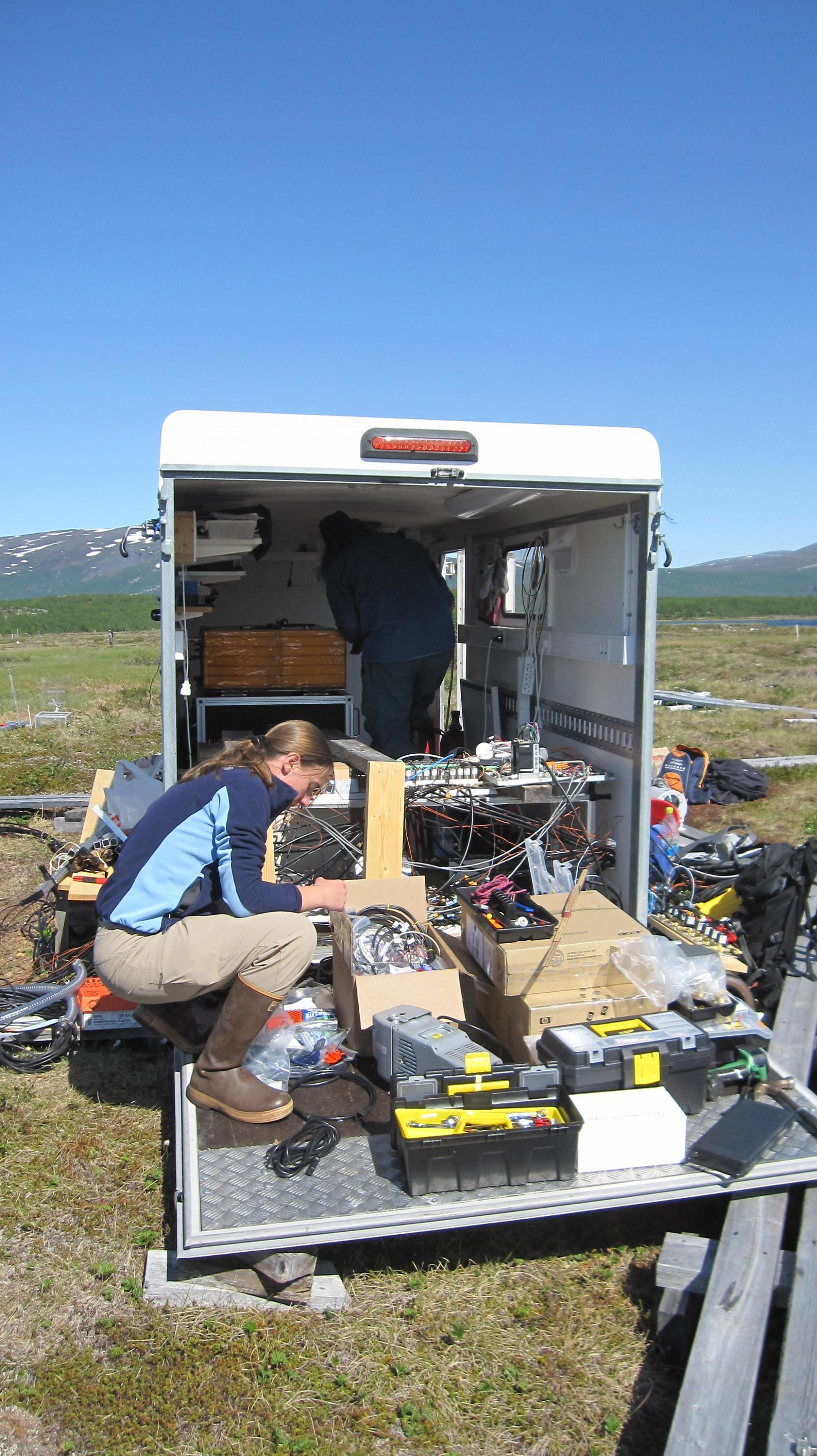 Carmody McCalley, a postdoctoral researcher in Saleska's group, installs equipment to measure the production of greenhouse gases by soil microbes.