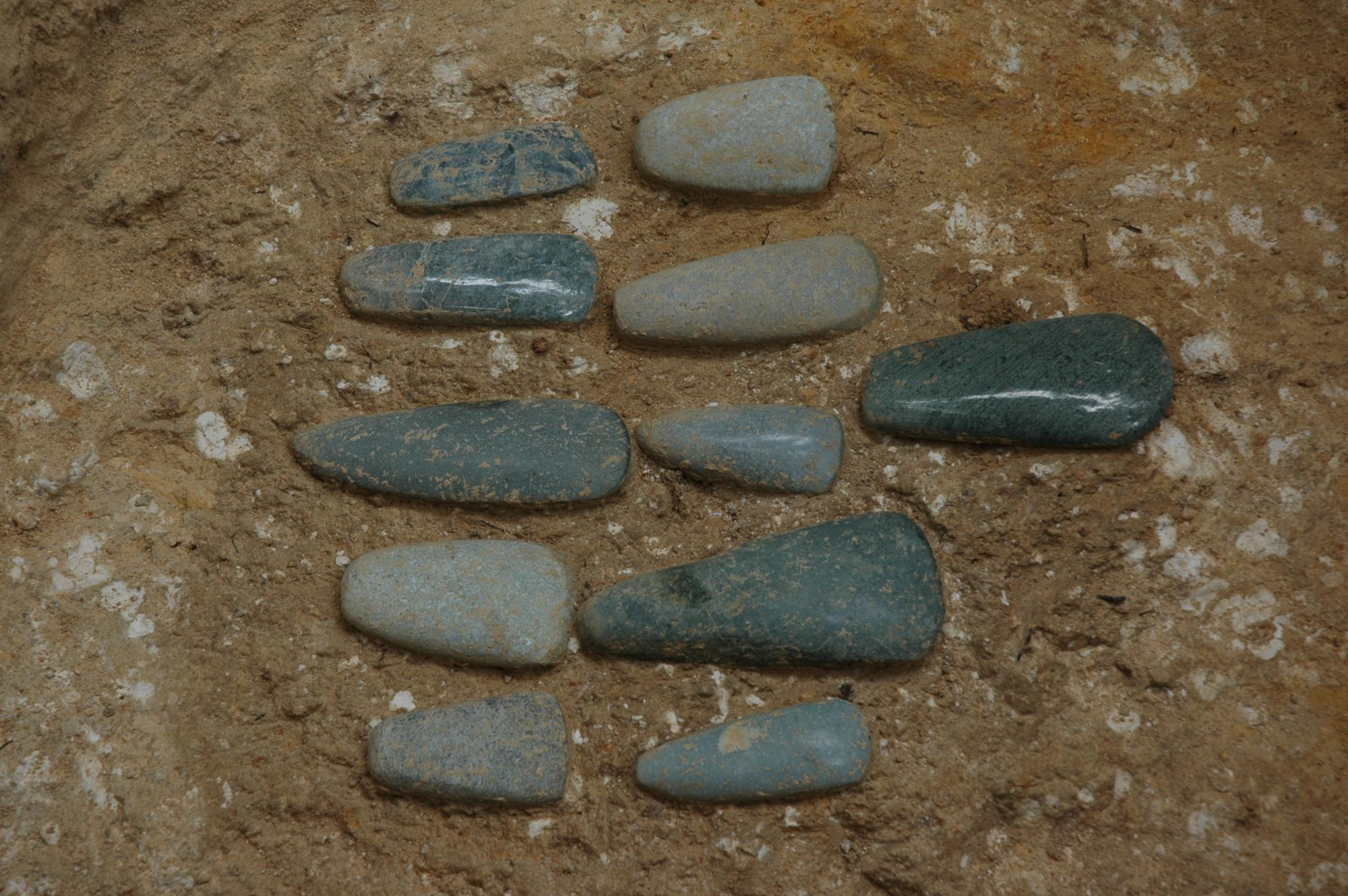 A jade axe offering found along the central axis of the solar temple complex of Ceibal