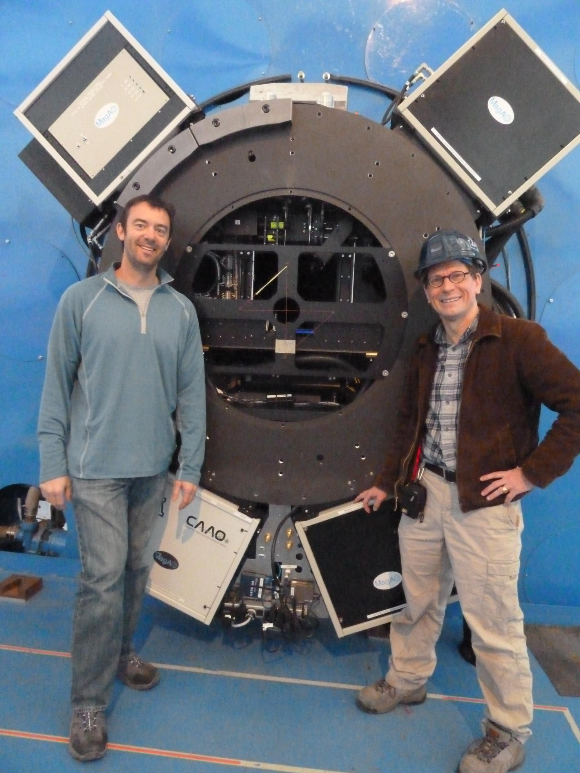 UA NASA Sagan Fellow and VisAO instrument scientist Jared Males  and UA Astronomy Professor and MagAO project scientist Laird Close with the VisAO camera and MagAO wavefront sensors at the focus of the 6.5m Magellan telescope that were used to make the vi