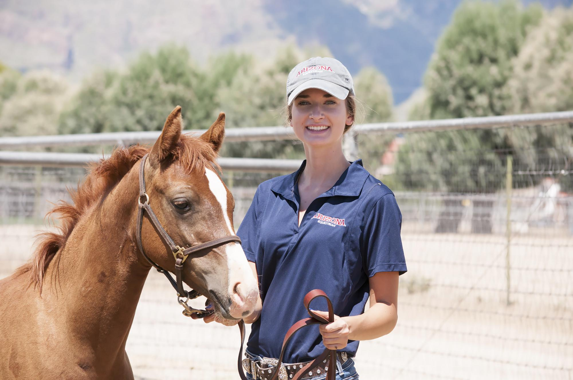 UA student Megan Hanson serves as a teaching assistant to help other undergrads train the University's four-legged freshmen.