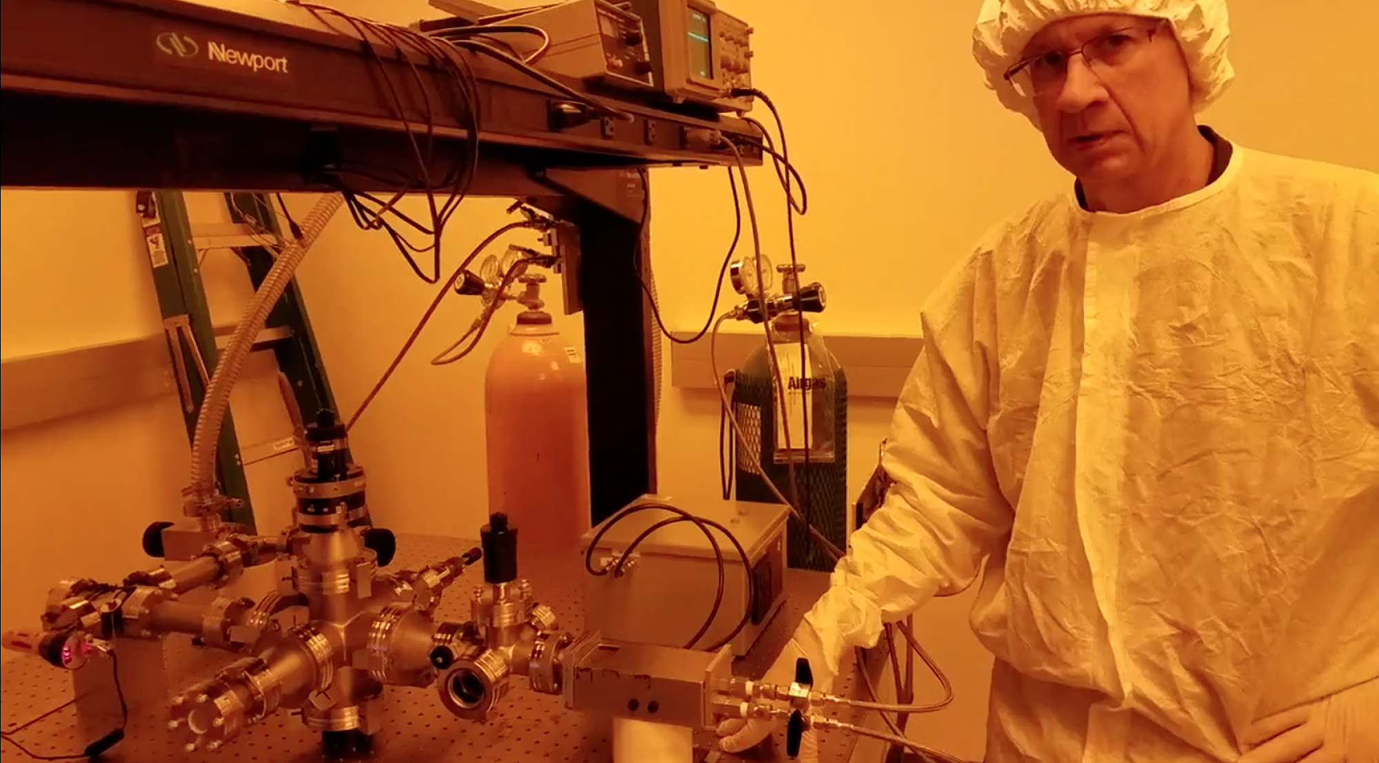 UA professor Tom Milster with the bench-top version of the new Raman ultraviolet spectrometer