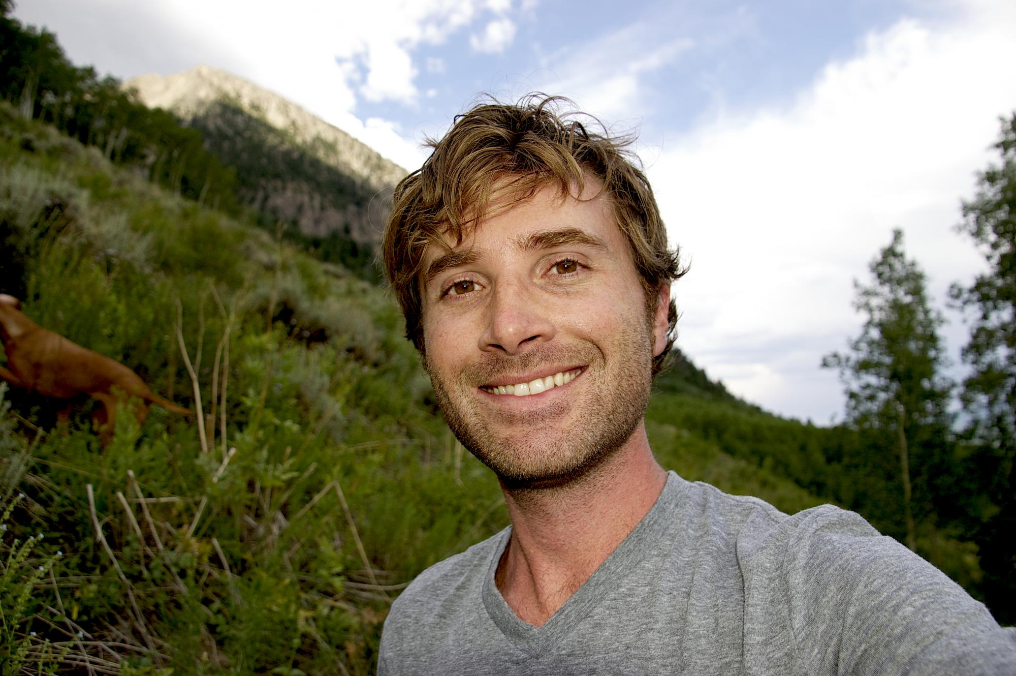The fly detective: Noah Whiteman, an assistant professor in the UA's department of ecology and evolutionary biology, searches for herbivorous flies atop Mount Crested Butte, Colo.