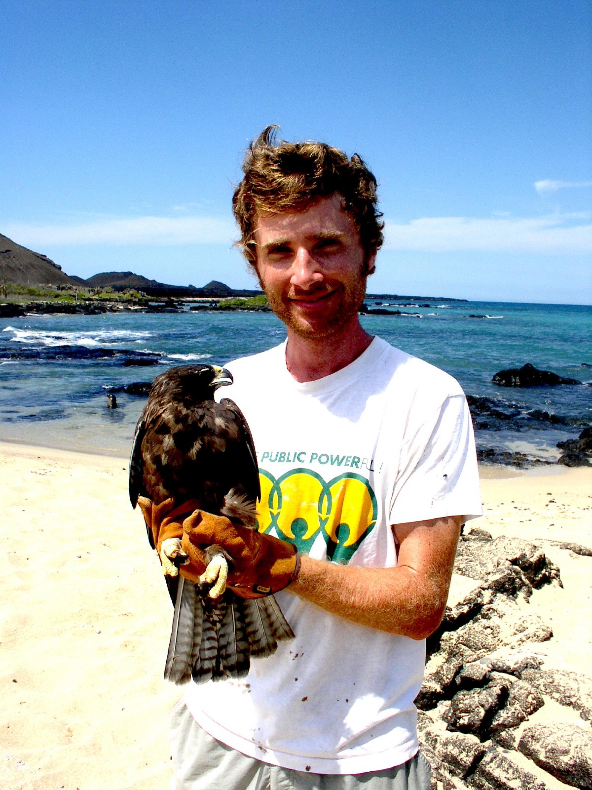 Noah Whiteman with a Galápagos hawk.