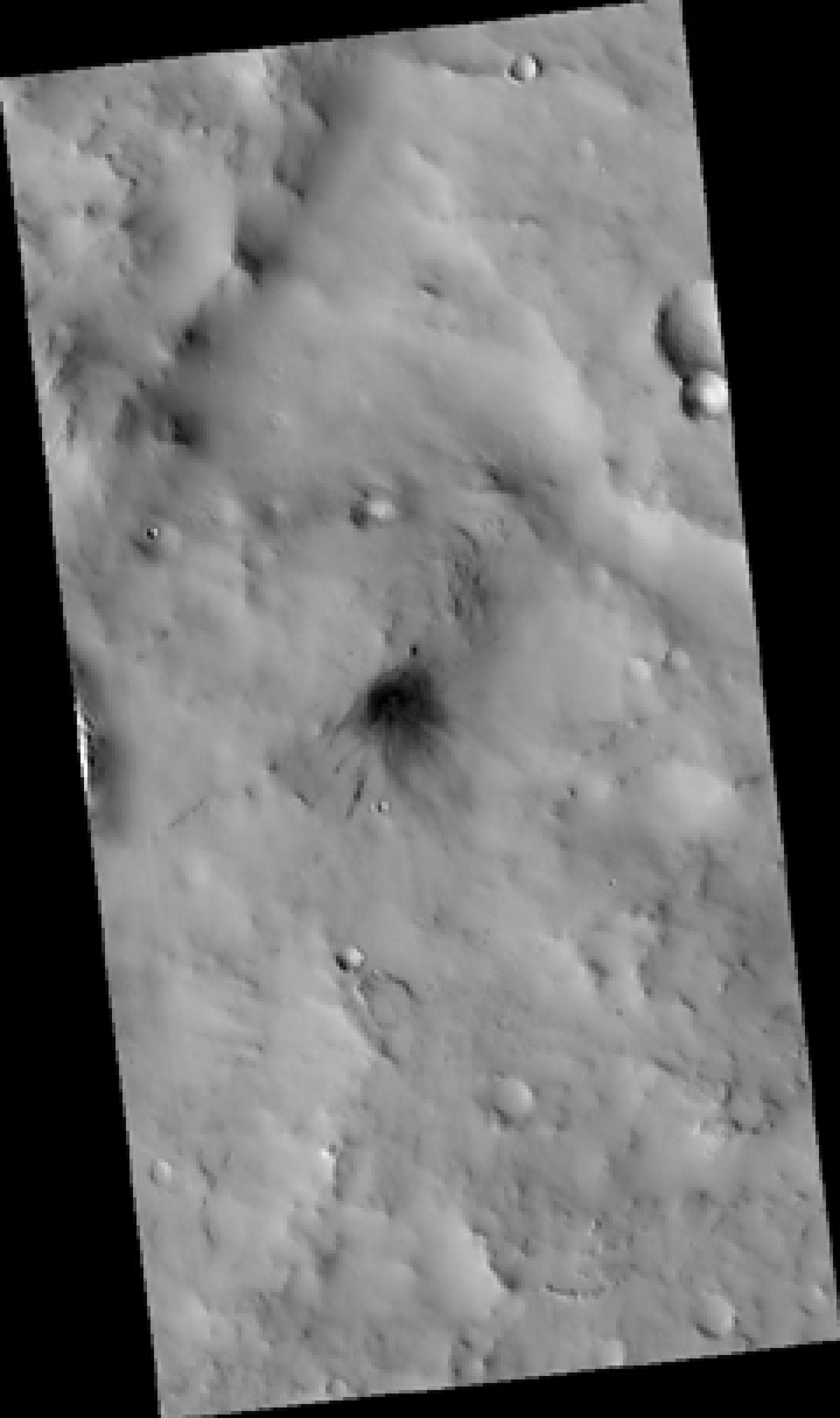 The High Resolution Imaging Experiment  camera operated at The University of Arizona returned this image  of a very recent dark impact crater. The impact happened only a few years or decades ago. The crater itself is small -- only about 60 feet wide -- bu