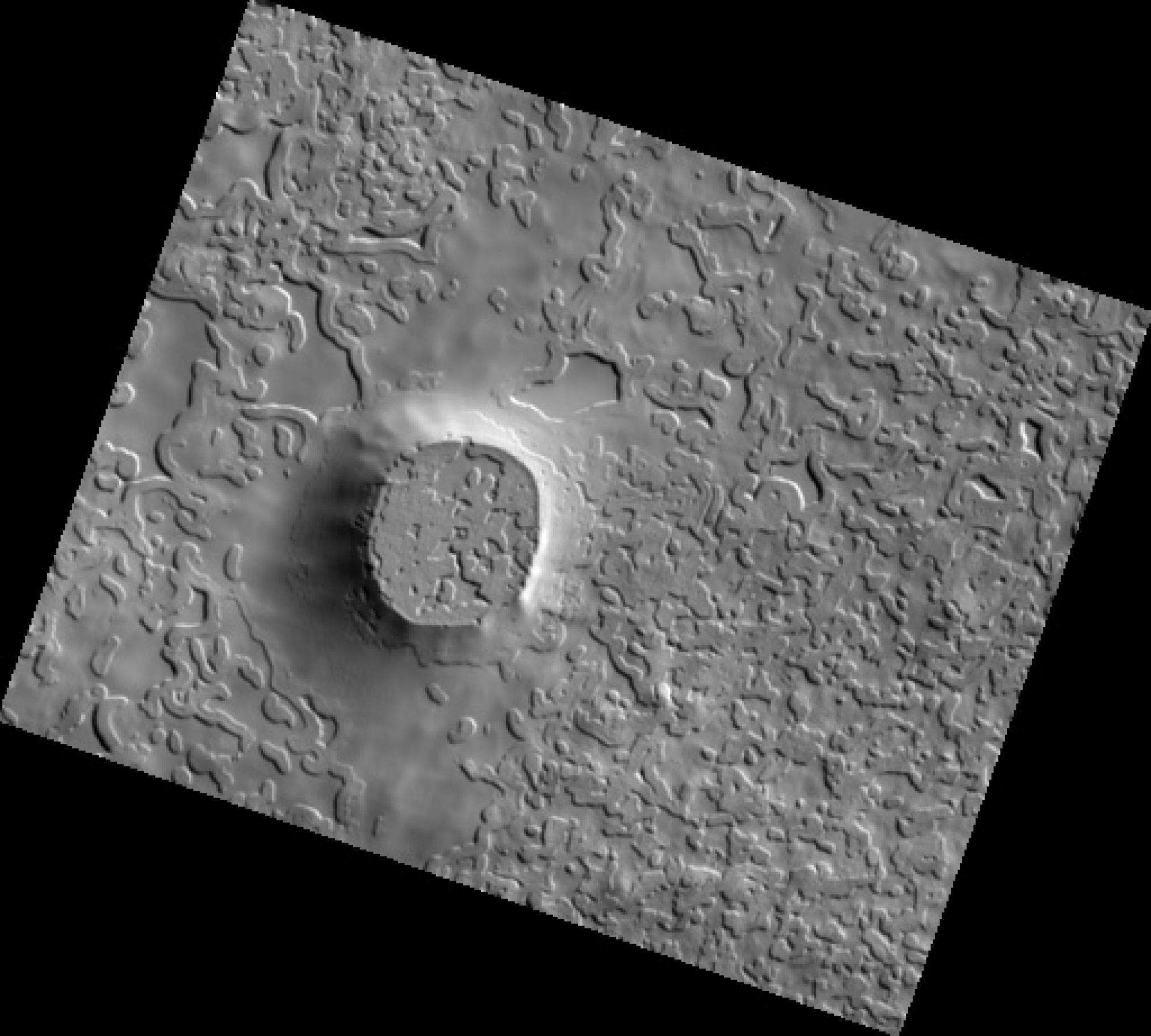 """The High Resolution Imaging Experiment  camera operated at The University of Arizona returned this image  of """"Swiss cheese"""" terrain found near Mars' south pole. The terrain is rich with carbon dioxide ice, which changes the shape of mesas and pits. Carbon"""