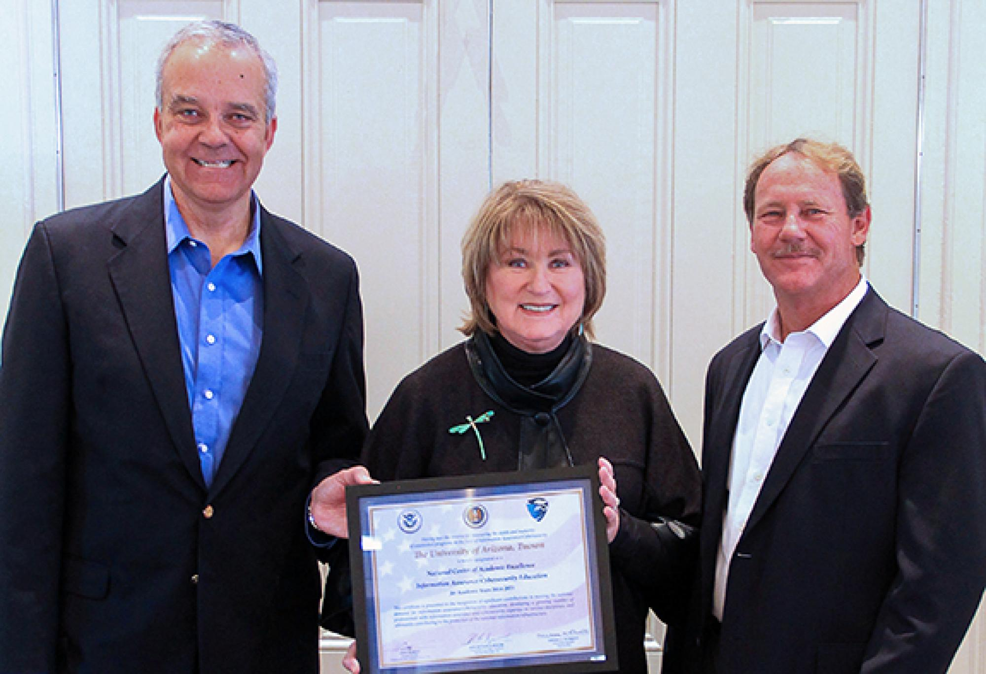 UA President Ann Weaver Hart with Paulo Goes , head of the MIS department, and Lance Hoopes, associate director of the Information Assurance and Security Education Center.
