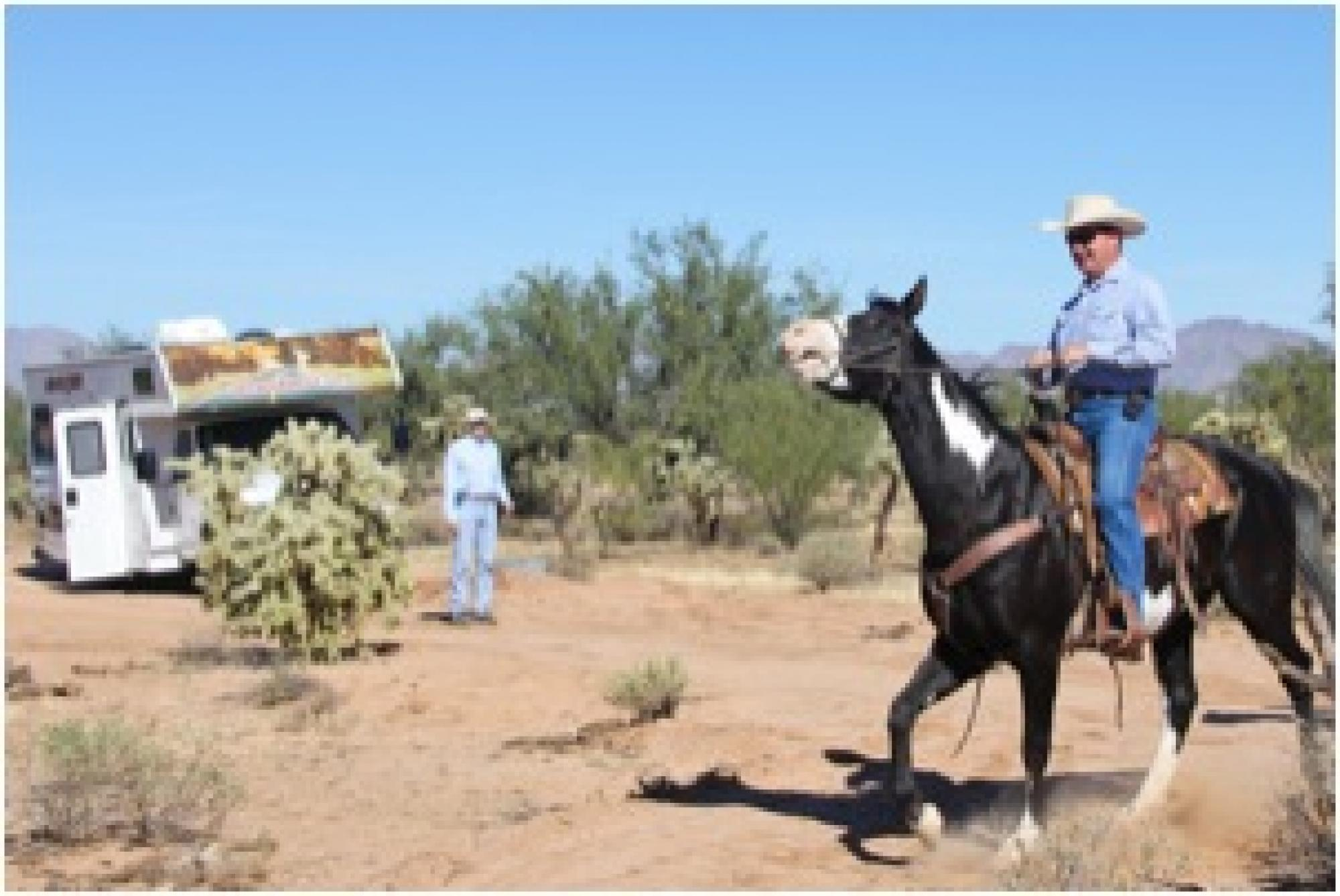 At the UA-Zonge engineering test site in the Sonoran Desert near Tucson, Brad Cowan of Cowan Horse Adventures in Southwest Tucson takes his 1,300-pound mare at a trot across the buried fiber-optic cable, which is connected to a Helios detection unit in th