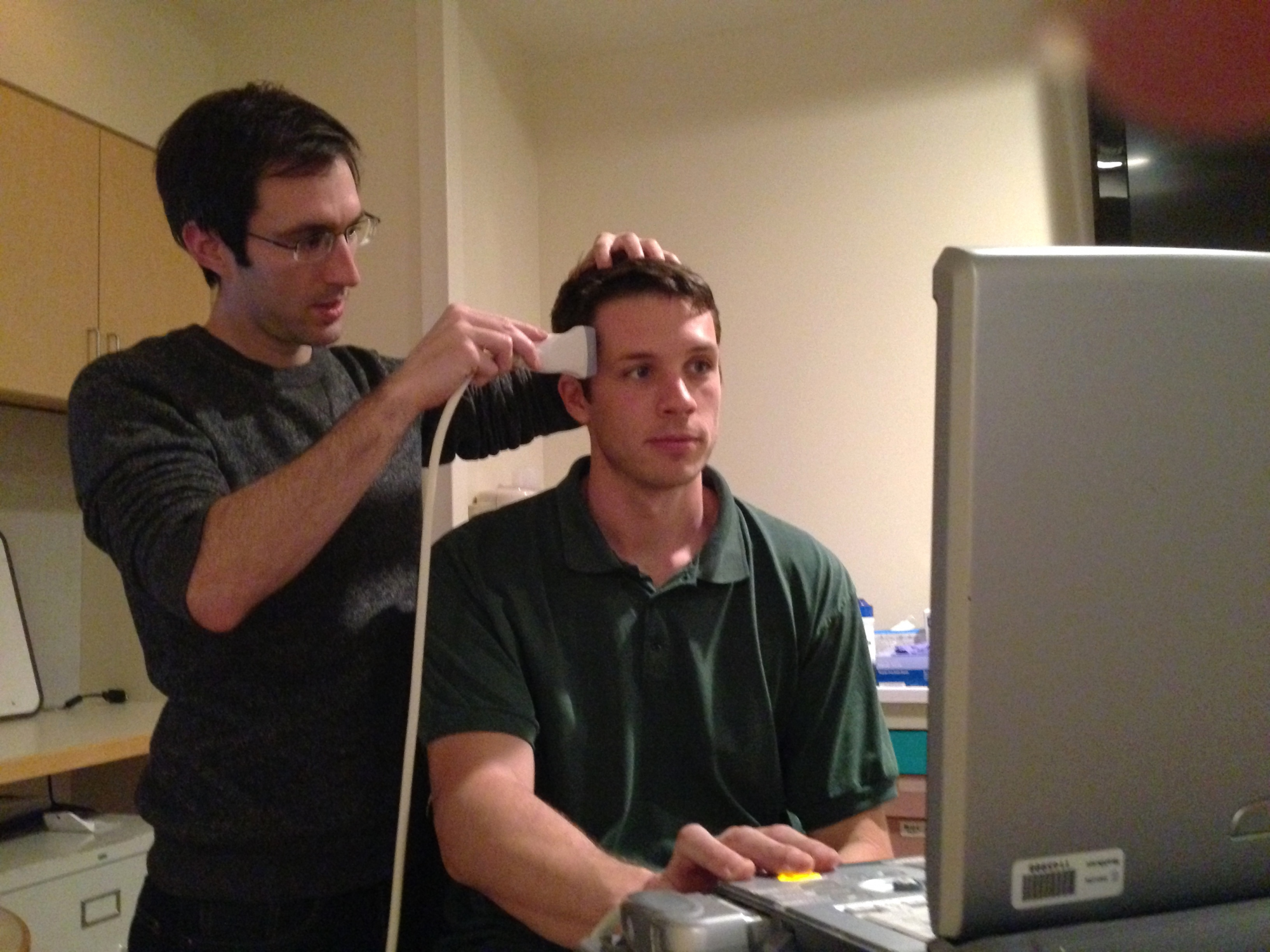 Jay Sanguinetti, a doctoral candidate the UA's department of psychology, administers brain ultrasound during a clinical trial.