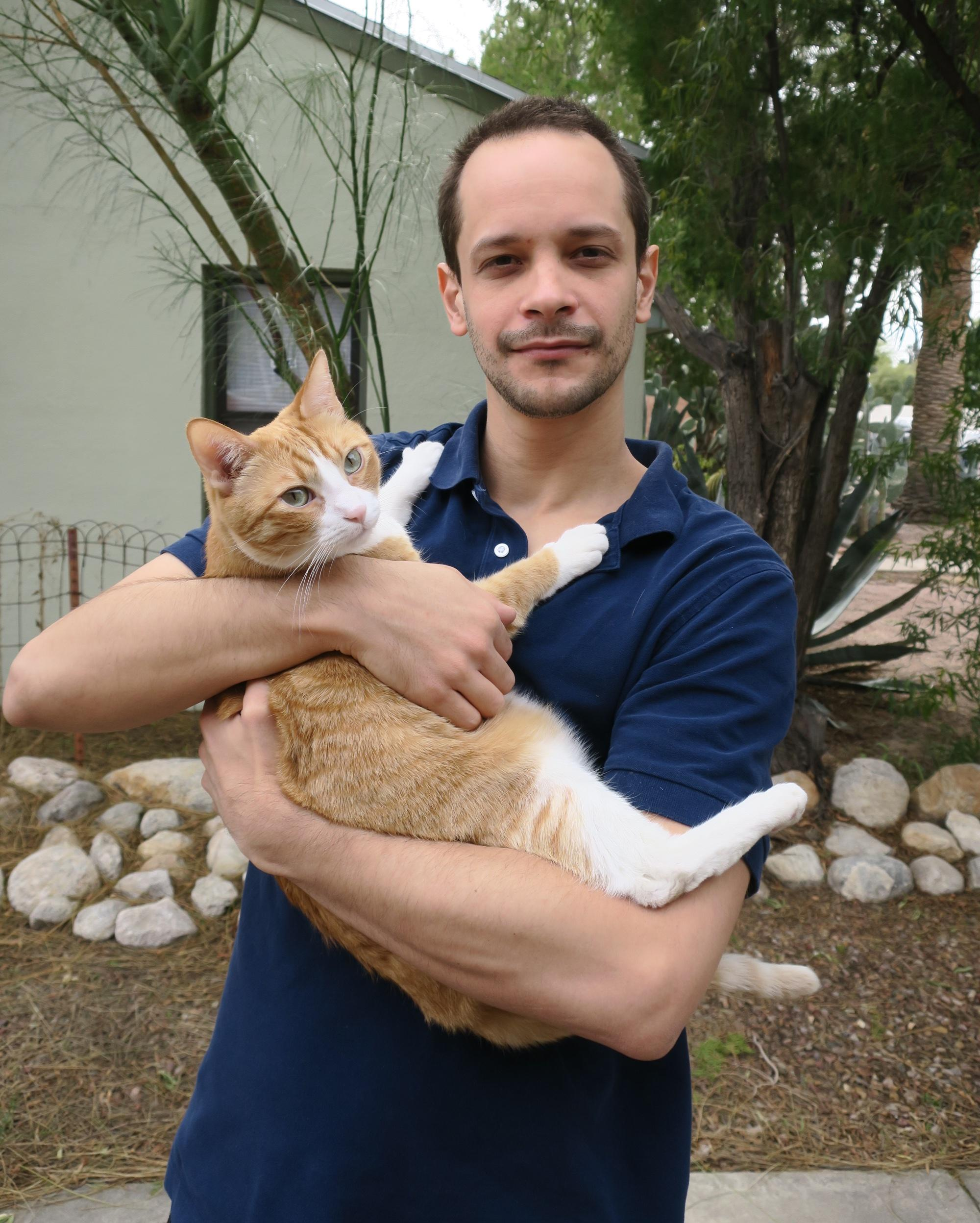 Uri Lifshin holds his cat, Chupchik. Lifshin's own love of animals is, in part, what drove him to study humans' psychological reasons for supporting killing them.