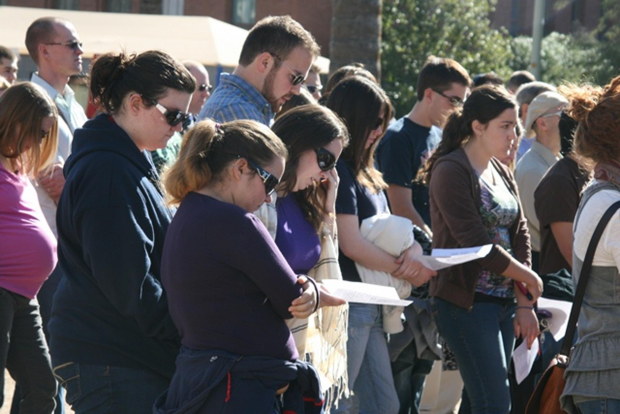 Hundreds of people attended an interfaith service at the UA Wednesday afternoon during which UA President Robert N. Shelton spoke.