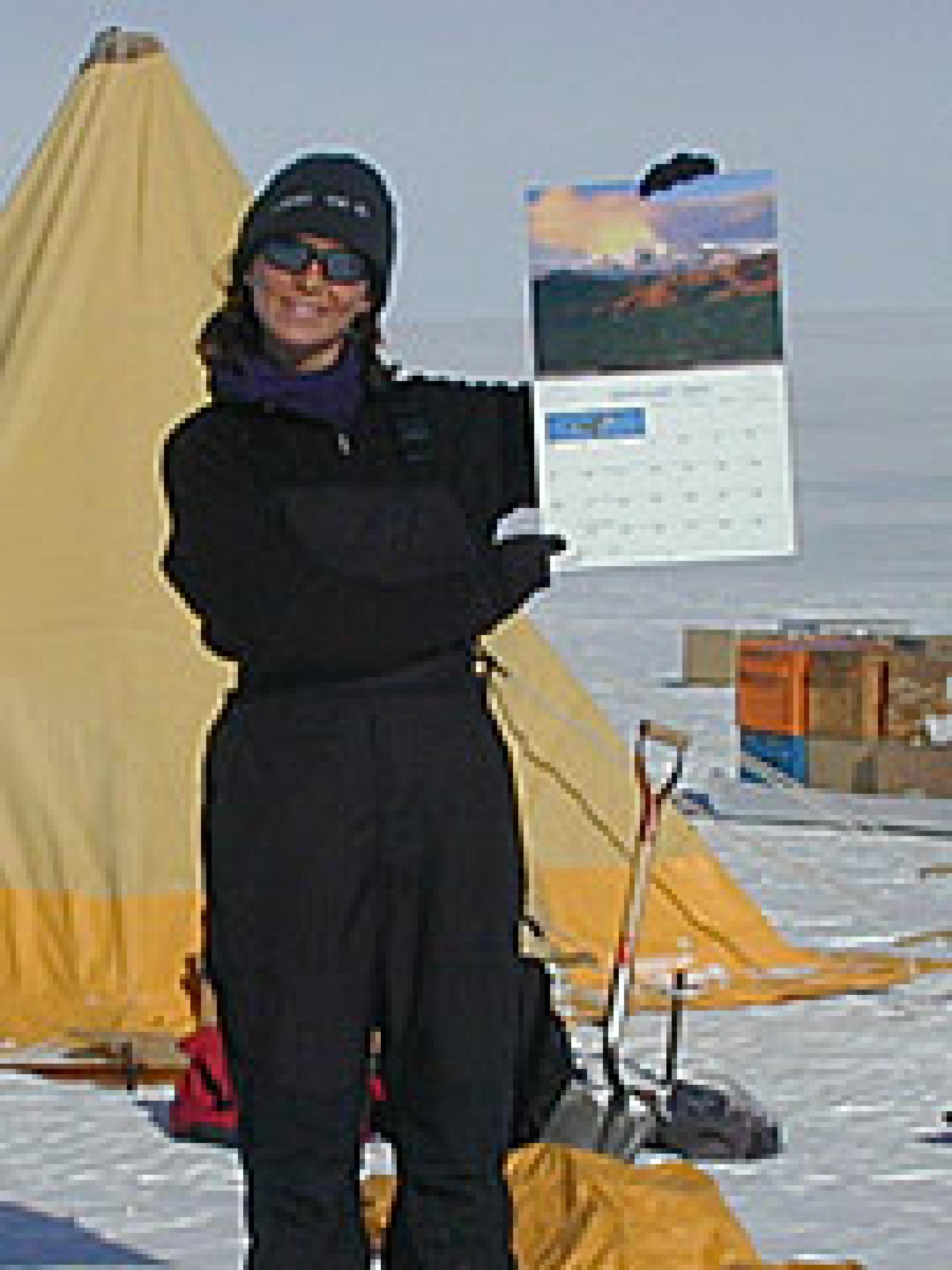 Goreva shows off her Arizona Highways calendar while camping on Earth's coldest, largest desert. .