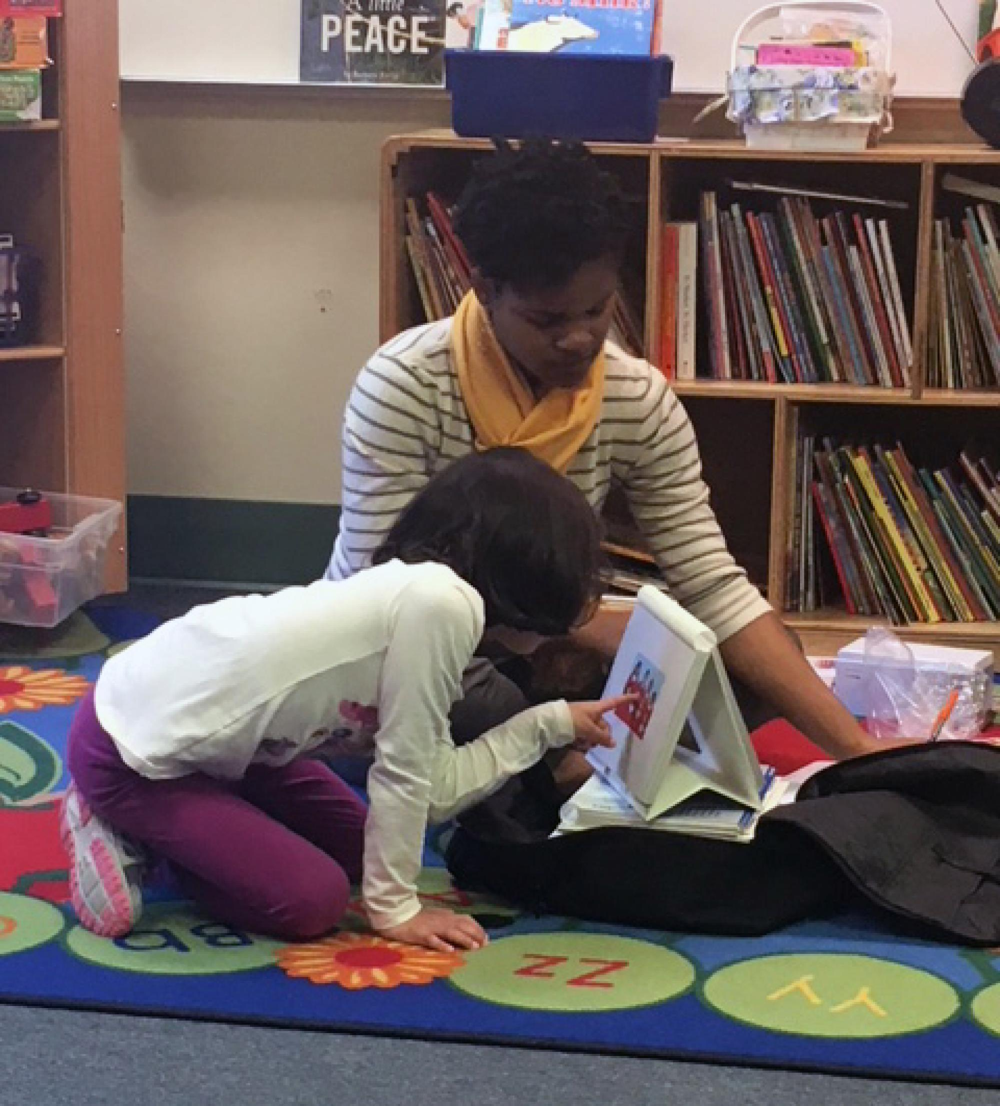 Chelsea Privette, a doctoral student in the  Department of Speech, Language and Hearing Sciences, works with a bilingual student.