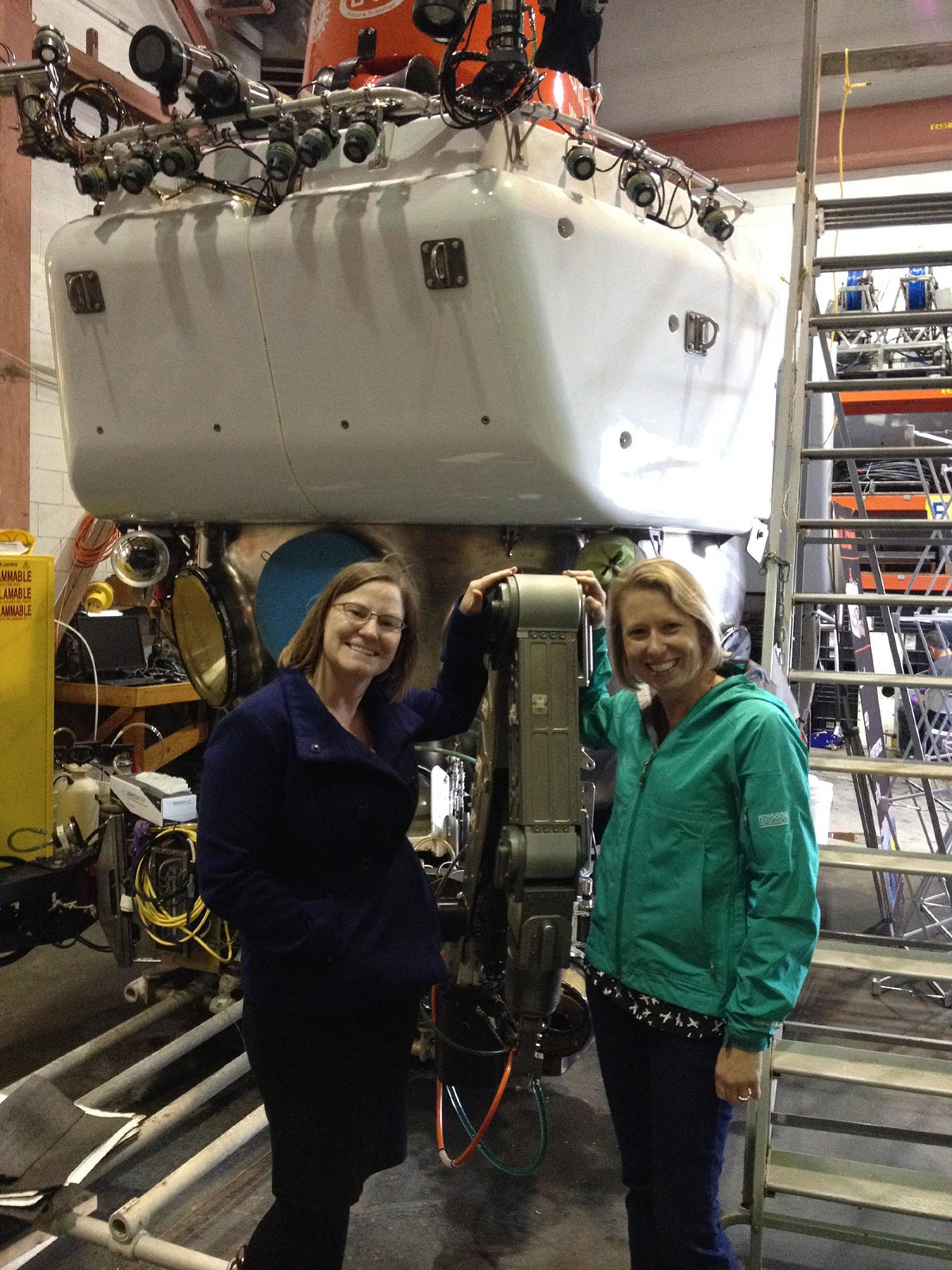 Hurwitz and Amy Apprill, associate scientist at Woods Hole Oceanographic Institution, in front of the human-piloted Alvin submersible. Deep-water samples are collected using the pod's robotic arm because the pressure of the water is too intense for divers