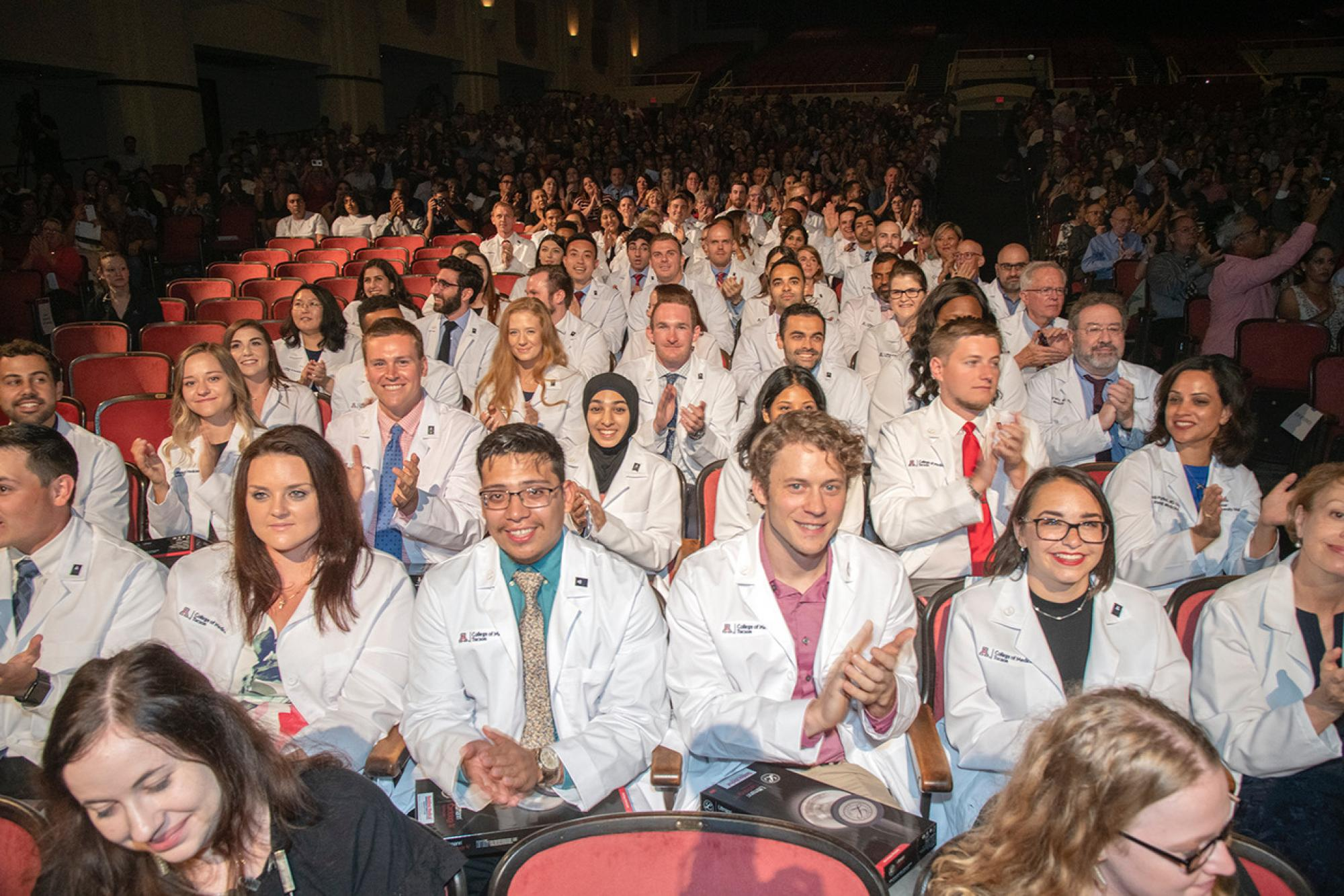 A large crowd filled Centennial Hall on July 26, as the Class of 2023 received their first white coats, signifying their acceptance into the College of Medicine – Tucson.