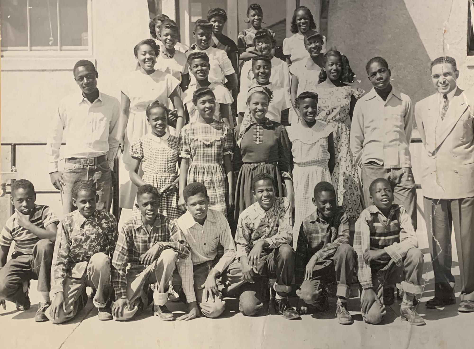 Dunbar School class photograph featuring Barbara Lewis, who is standing in the row second from the bottom, third from the left.
