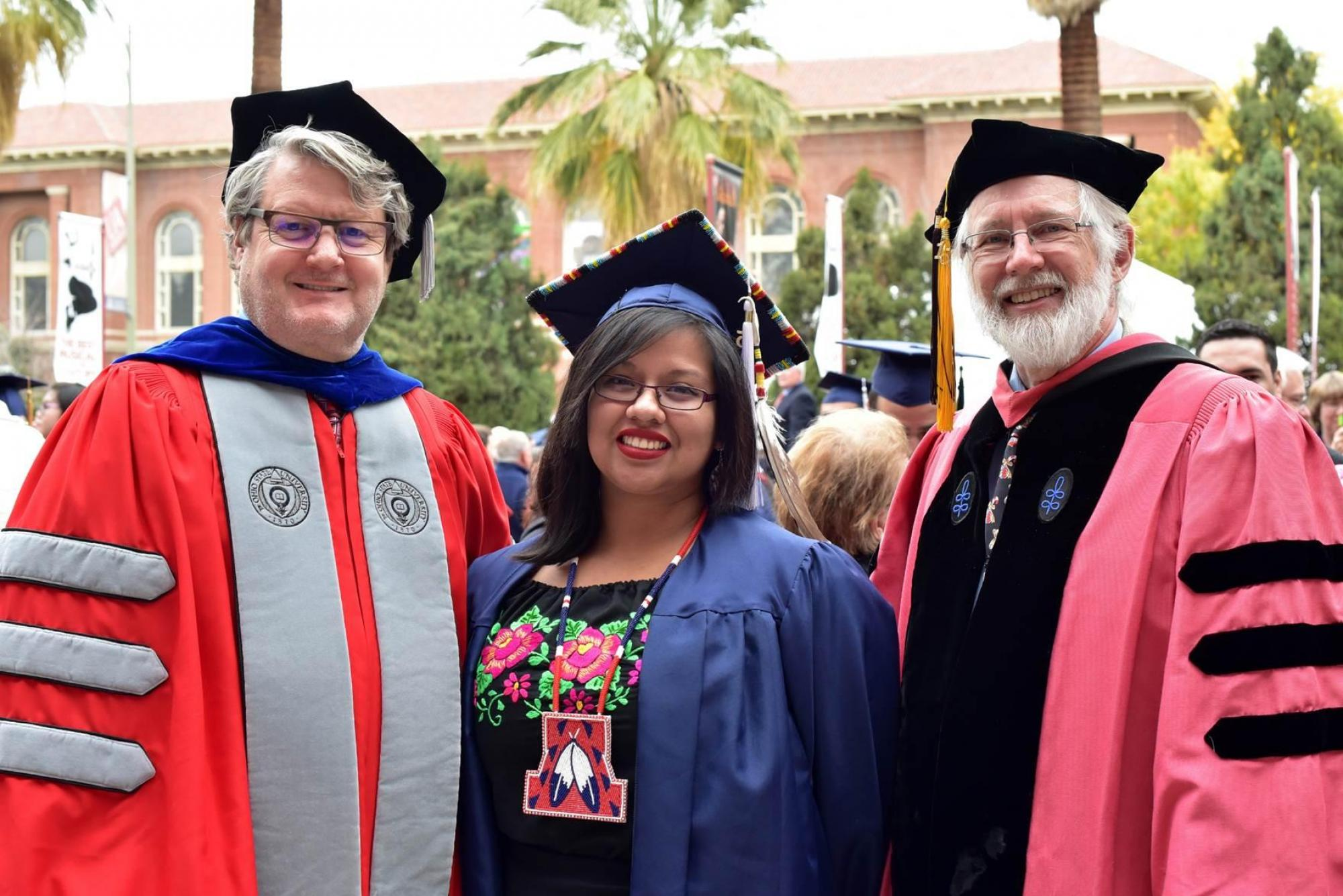 Maria Escalante, one of the first students to graduate from the UA's Bachelor of Arts degree in American Indian studies, with John Paul Jones III, dean of the UA College of Social and Behavioral Sciences, and Ronald Trosper, an American Indian studies pro