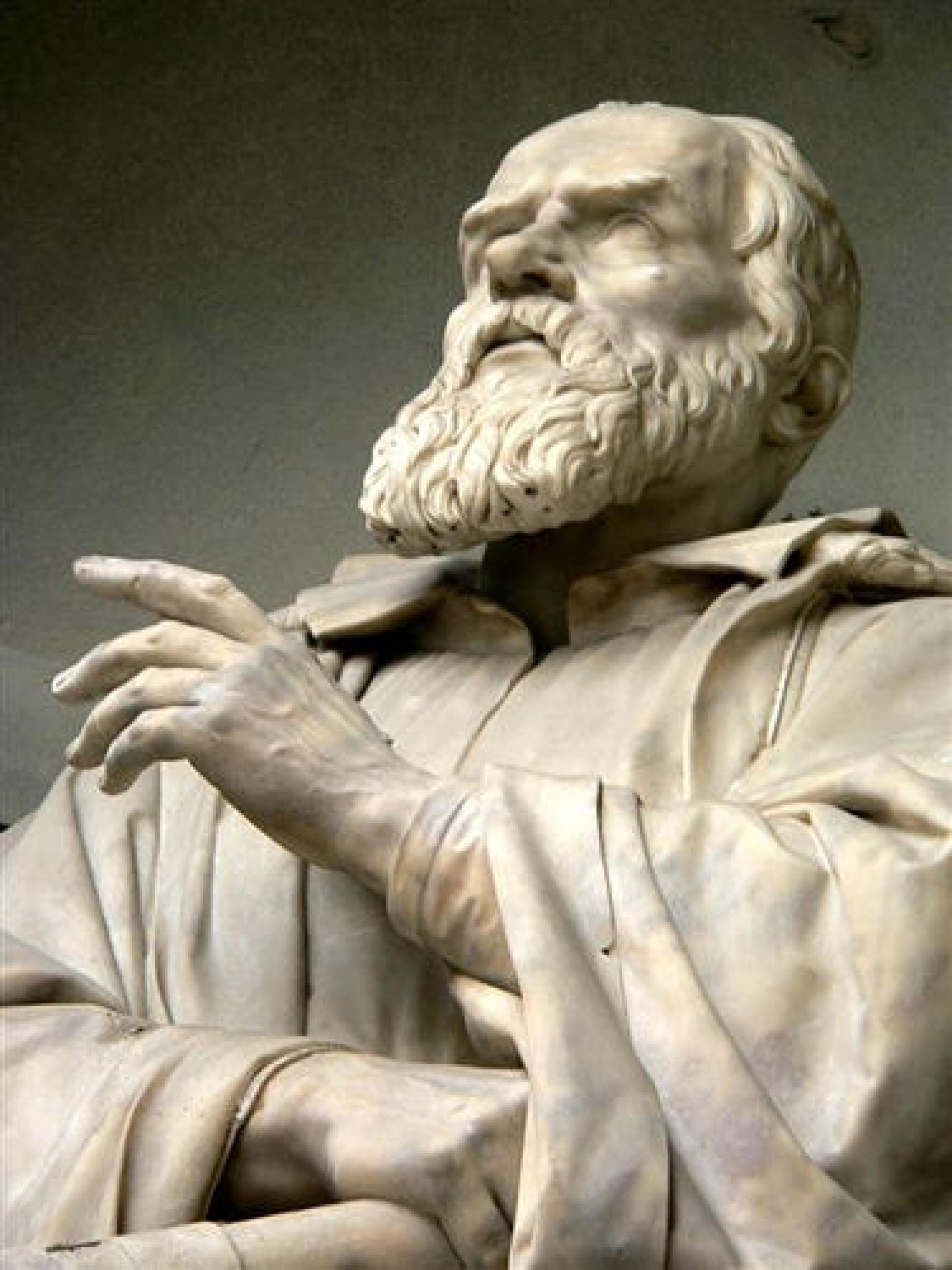 CLICK TO ENLARGE IMAGE. This 19th century sculpture of Galileo Galilei is found in a niche on the outer wall of the Uffizi Palace in Giorgio Vasari's Court just off the Piazza della Signoria in Florence, Italy.