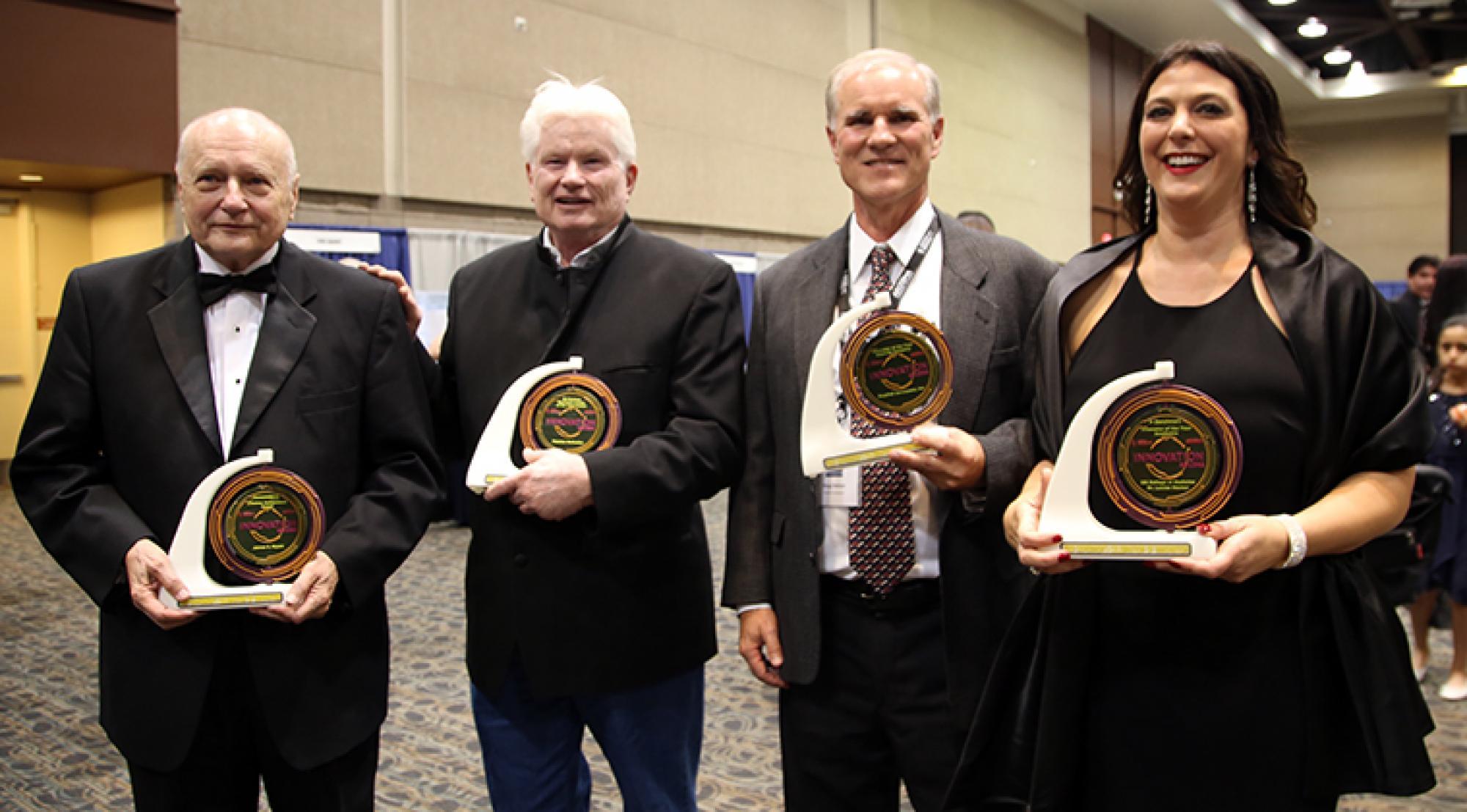 James C. Wyant, Fletcher McCusker, Doug Stetson and Louise Hecker