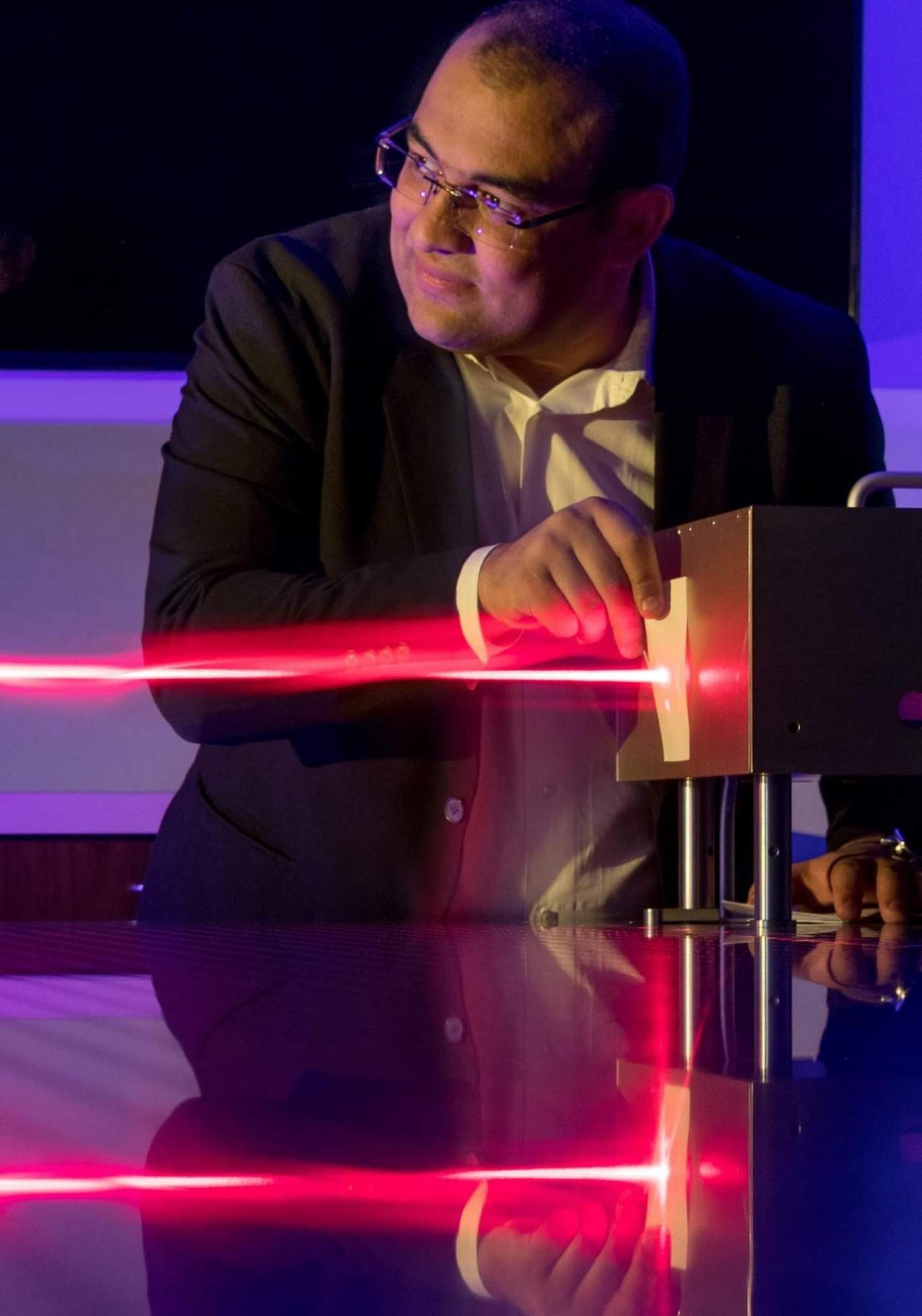 """Mohammed Hassan, a University of Arizona assistant professor of physics and optical sciences, wants to be the first to photograph an electron in motion. """"The idea of seeing something humans have never seen before drives me,"""" Hassan said."""