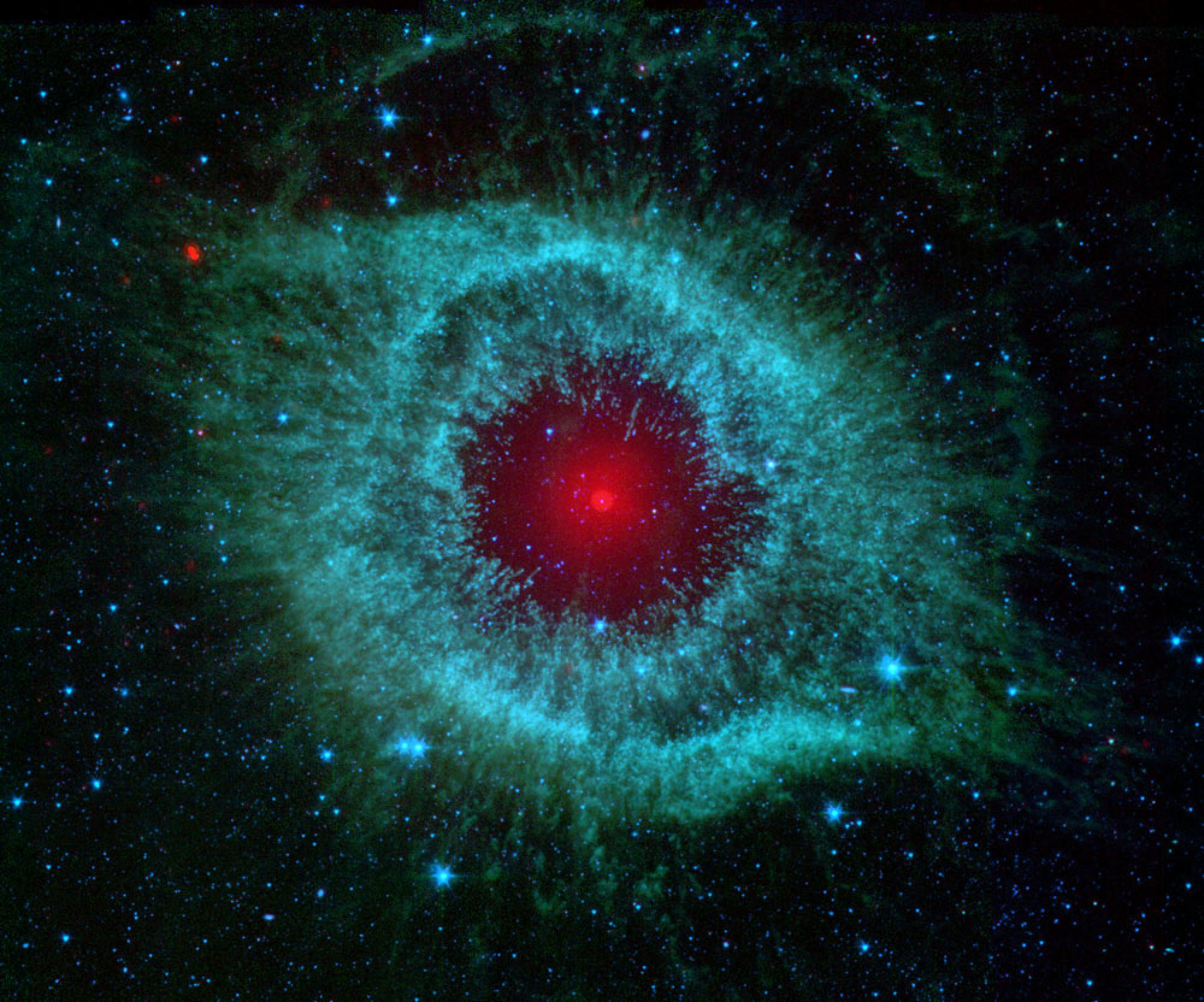 The Spitzer Space Telescope has provided glimpses into the very beginnings of our own existence as well as into the far future of our solar system. This infrared image shows the Helix nebula, which is located about 700 light-years away in the constellatio