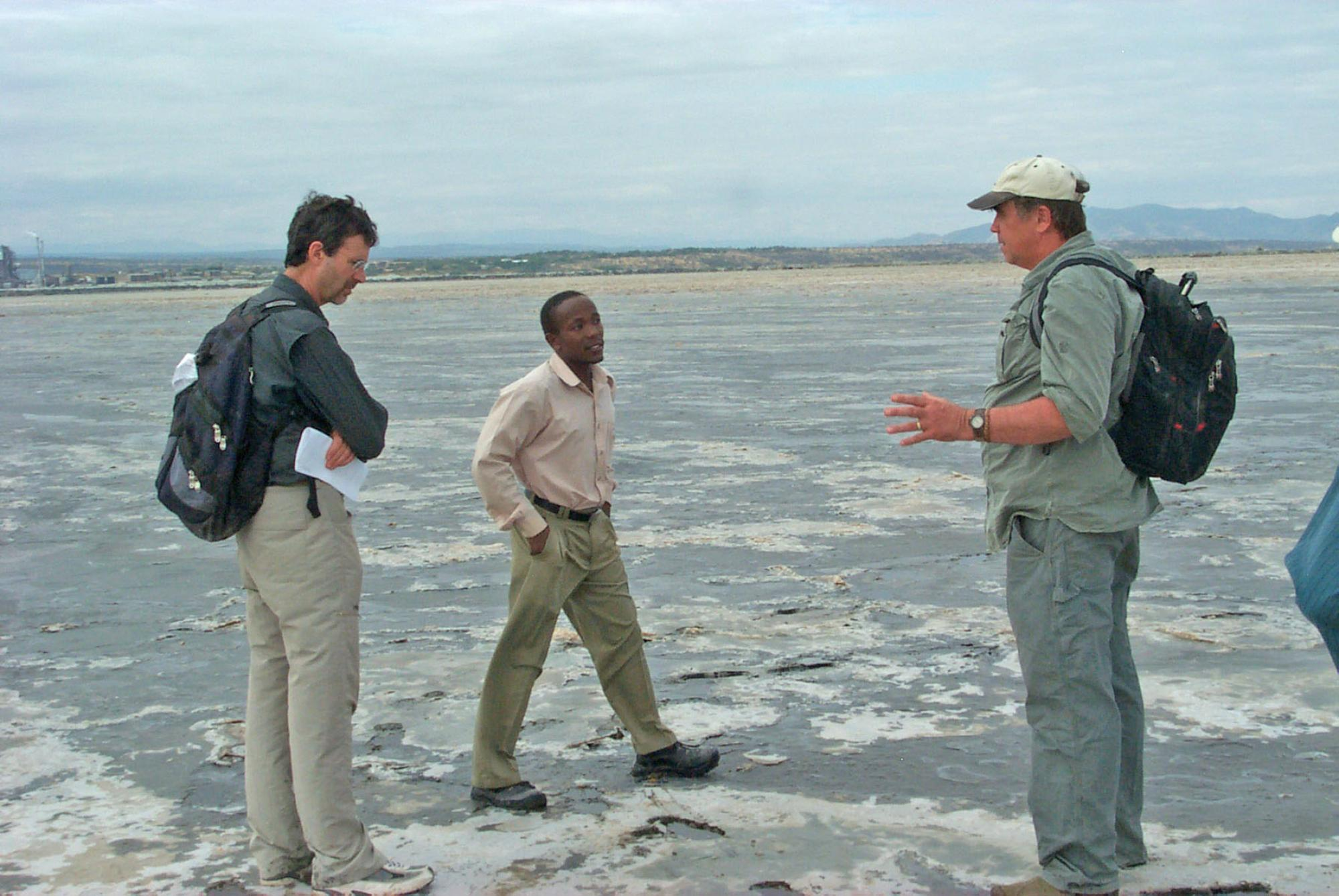 Professor Andrew S. Cohen  with HSPDP colleagues Anthony Mbuthia  and Doug Schnurrenberger at Lake Magadi, Kenya, a dry soda lake, where one of the drill cores will be collected.