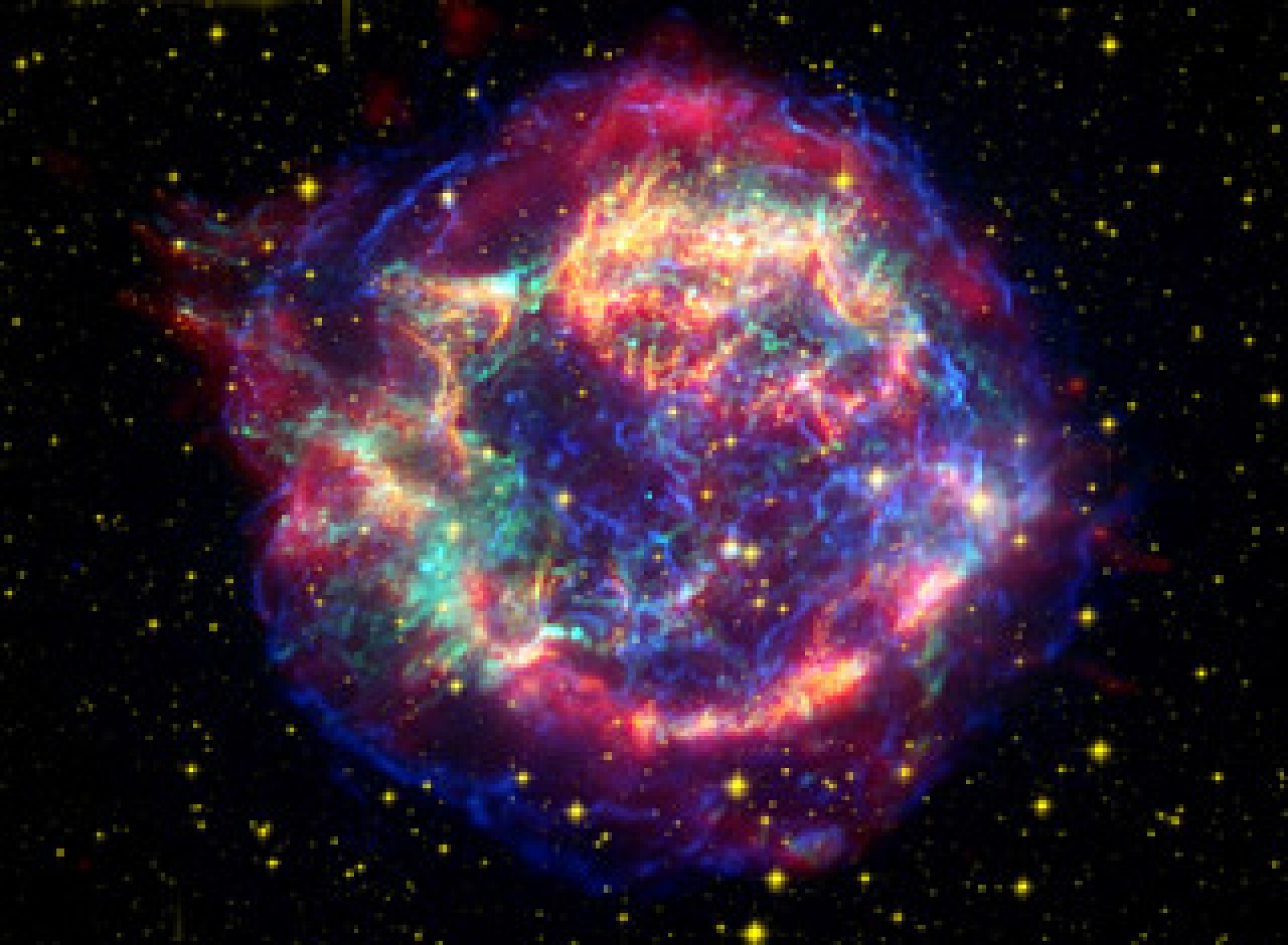 This stunning false-color picture shows off the many sides of the supernova remnant Cassiopeia A. It is made up of images taken by three of NASA's Great Observatories, using three different wavebands of light. Infrared data from the Spitzer Space Tel