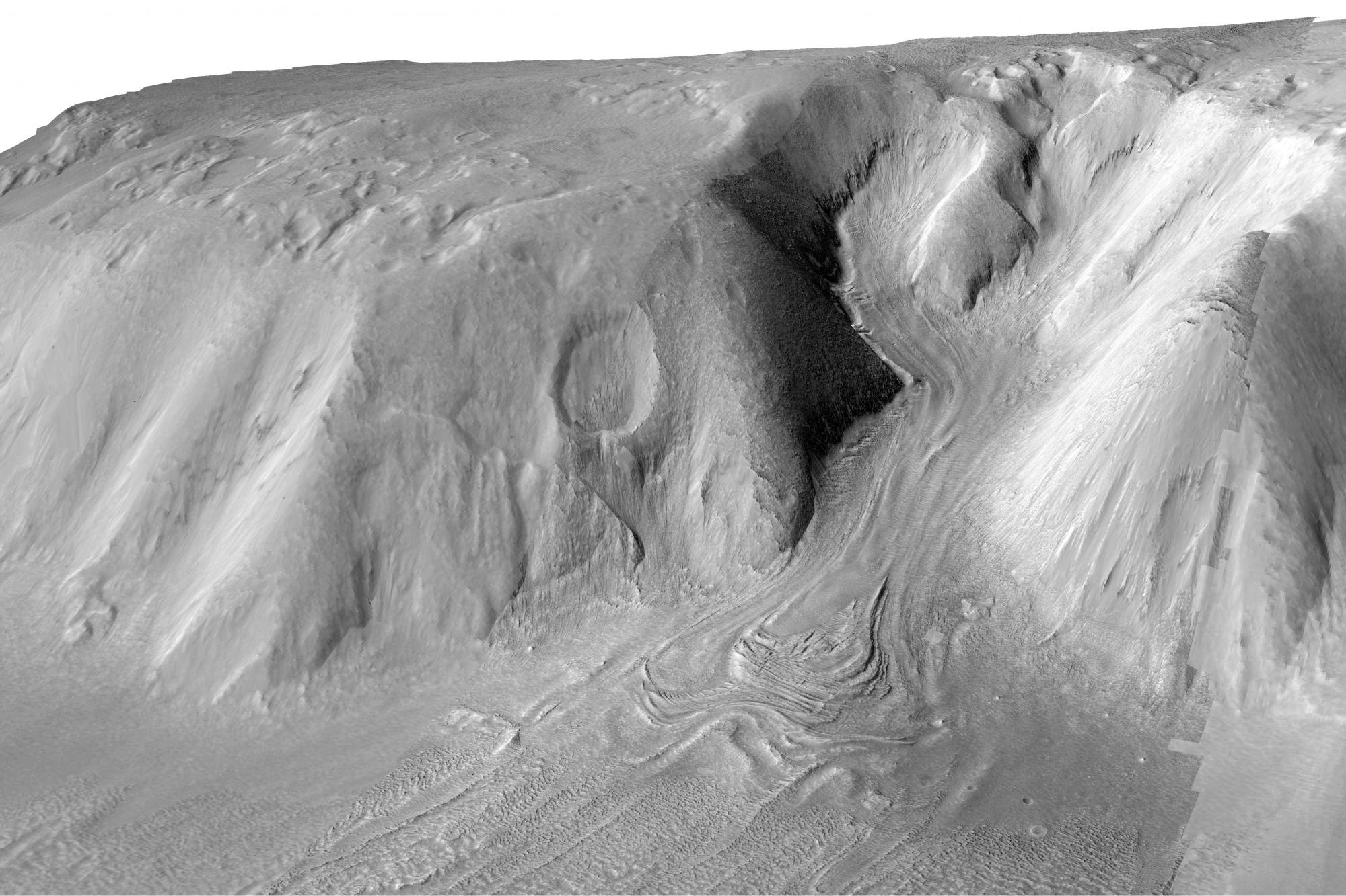 """The folds, compressional ridges and flow lines on this debris-covered glacier on Mars are strikingly similar to the appearance of features on Sourdough Peak. Planetary scientists often turn to """"Earth analogs"""" to understand what shapes landscapes on other"""