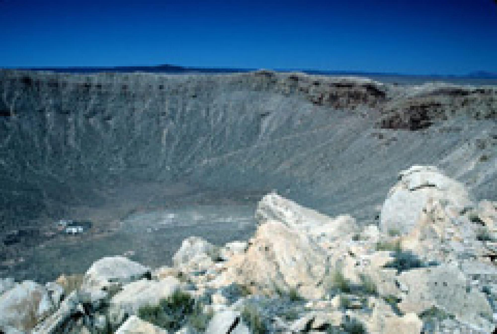 Meteor Crater, also called Barringer Meteorite Crater. This view contrasts the boulders on the east rim with the deep interior.
