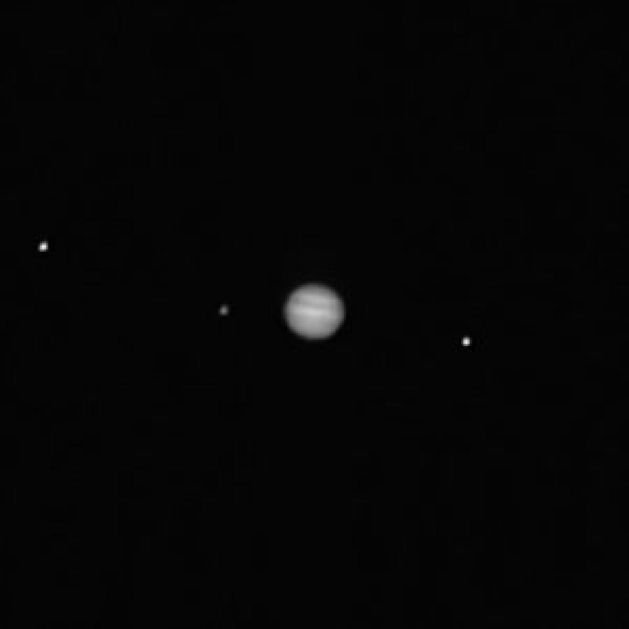 The PolyCam imager on-board OSIRIS-REx captured this image of Jupiter  and three of its moons, Callisto , Io, and Ganymede. The image was taken on Feb. 12, when the spacecraft was 76 million miles  from Earth and 418 million miles  from Jupiter.