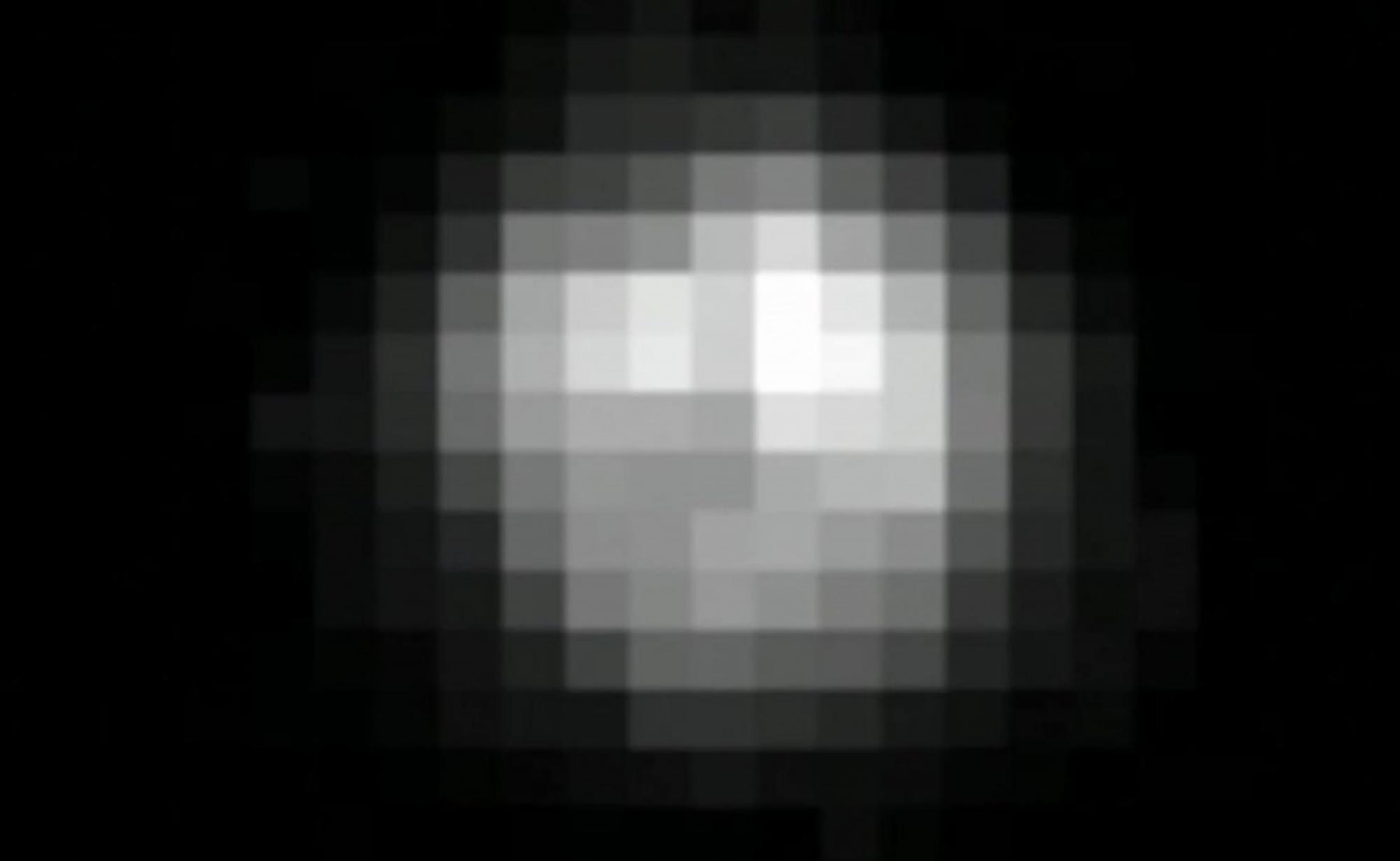 This pixelated, blurry image, taken with the Hubble Space Telescope, is the best view of Pluto that was available before the New Horizons mission.