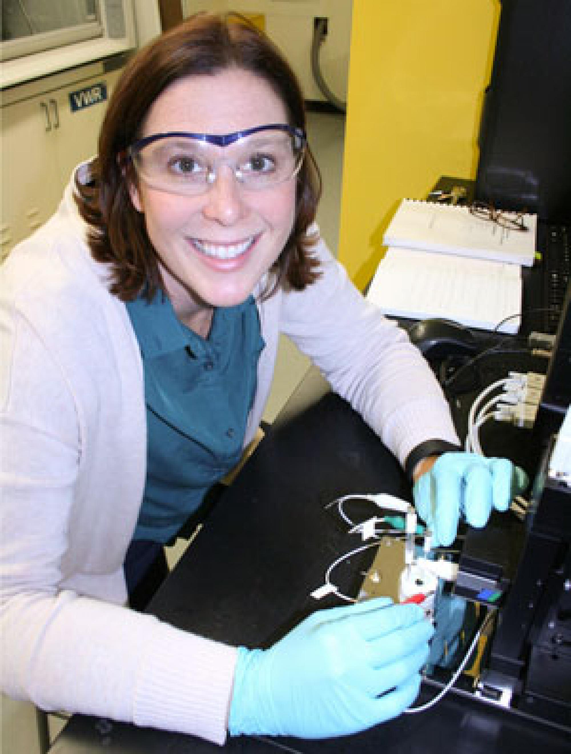 """""""Having two women principal investigators on a project like this is really cool,"""" says assistant professor Erin Ratcliff, pictured in her lab. Ratcliff works to increase diversity in engineering and serves on the UA Commission on the Status of Women."""