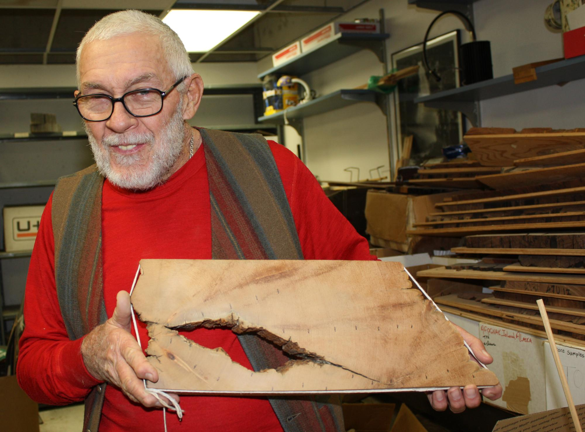 UA dendrochronologist Rex Adams holds up the innermost piece of the roughly 5,000-year-old tree, Prometheus.