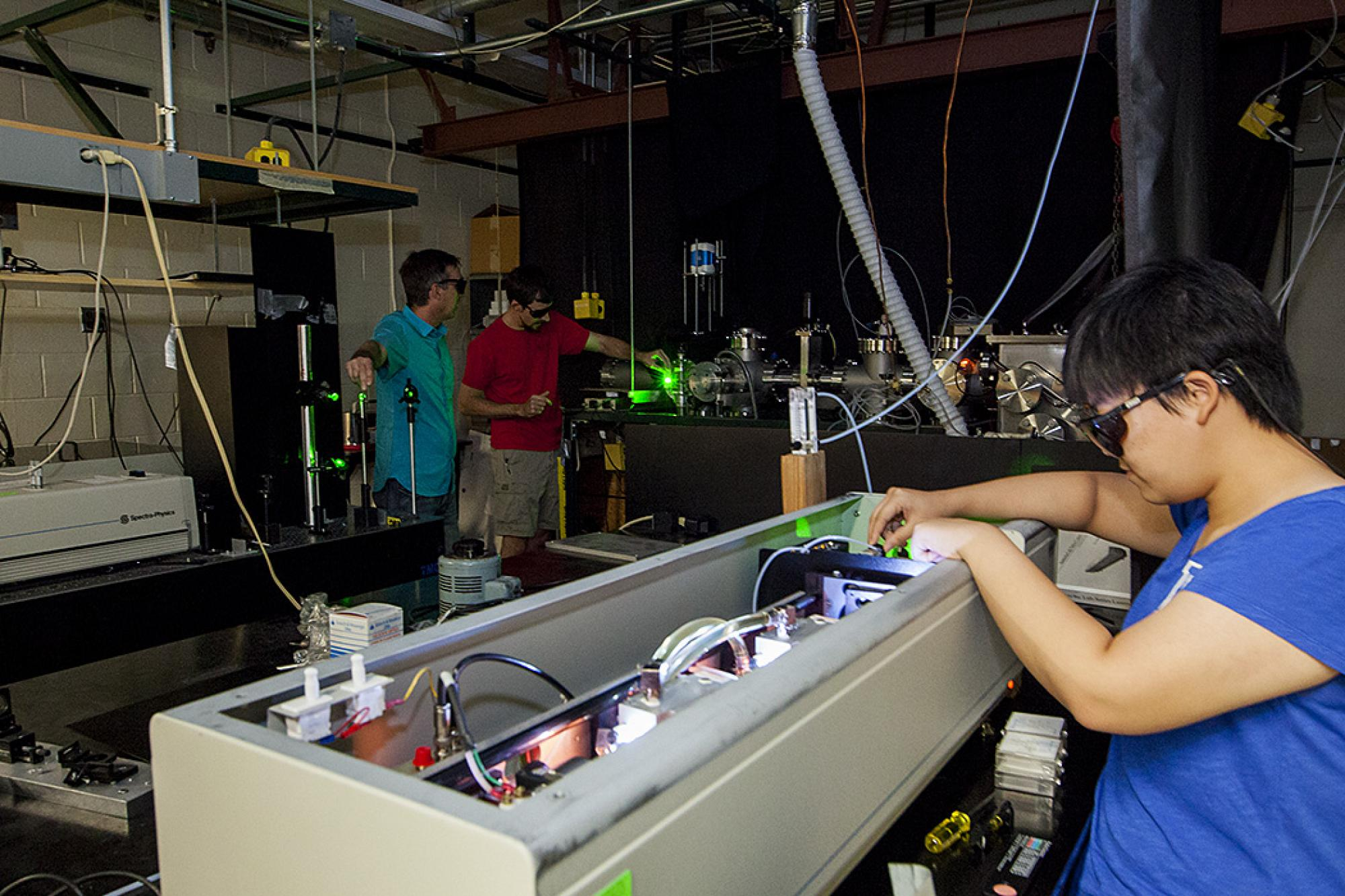 Andrei Sanov and his doctoral student Andrew Dixon redirect laser from the Nd: yittrium aluminum garnet laser and into the Negative Ion Photo Electron Imaging Spectrometer, the custom-made instrument the team used to isolate and document the elusive ethyl