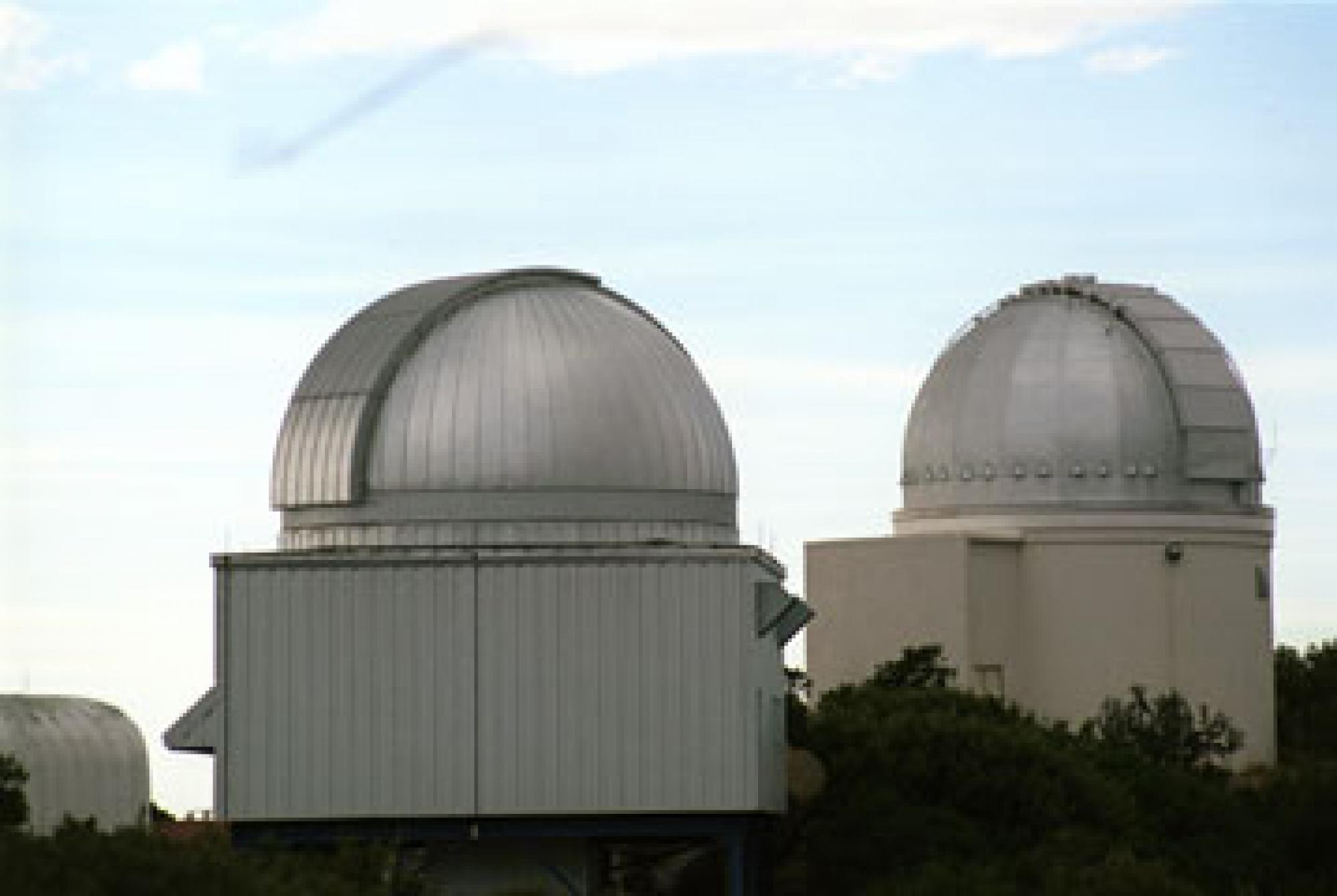 The Spacewatch telescopes. The 0.9-meter  telescope is the one on the right.