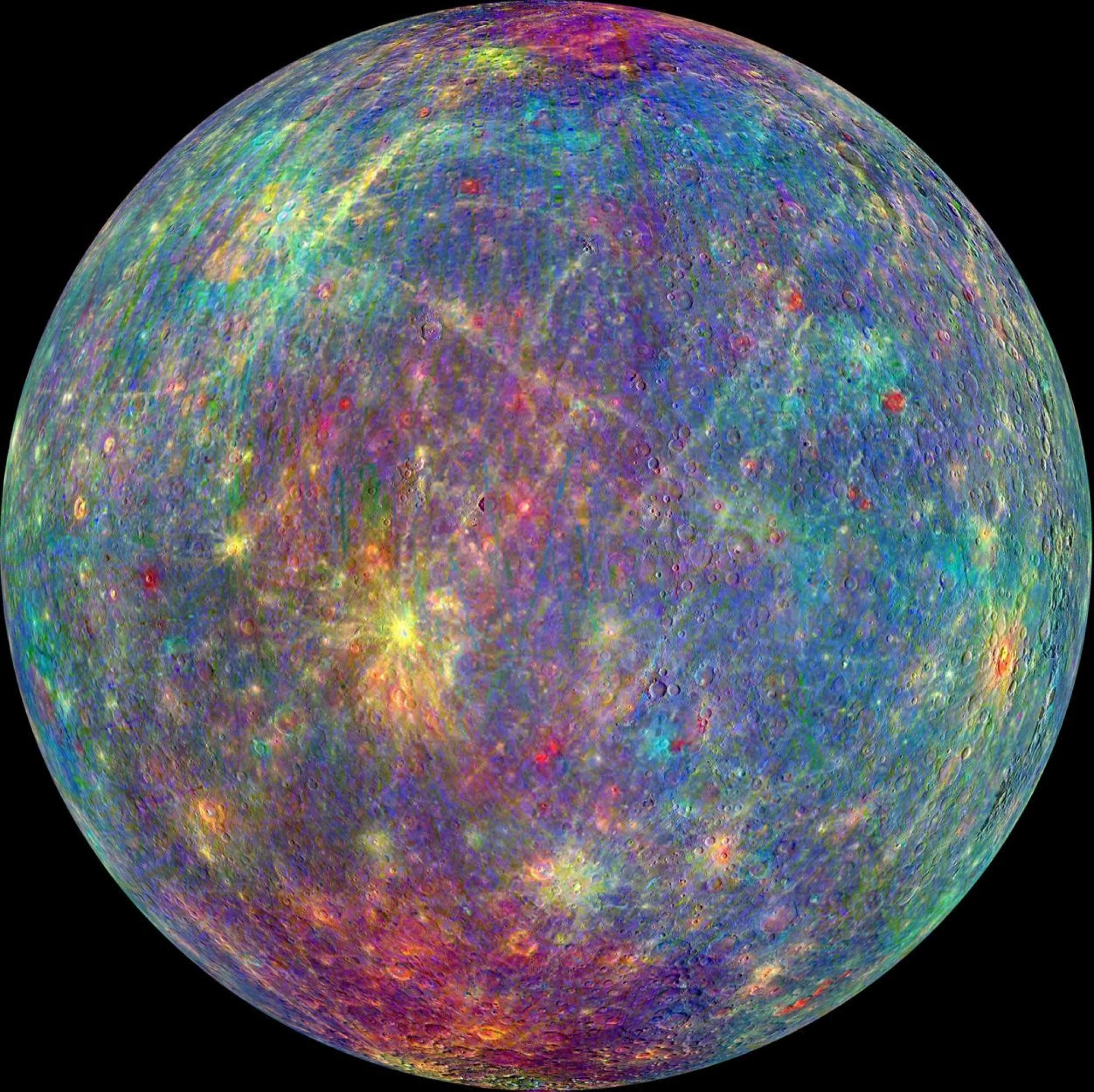 Though Mercury may look drab to the human eye, different minerals appear in a rainbow of colors in this image from NASA's MESSENGER spacecraft.