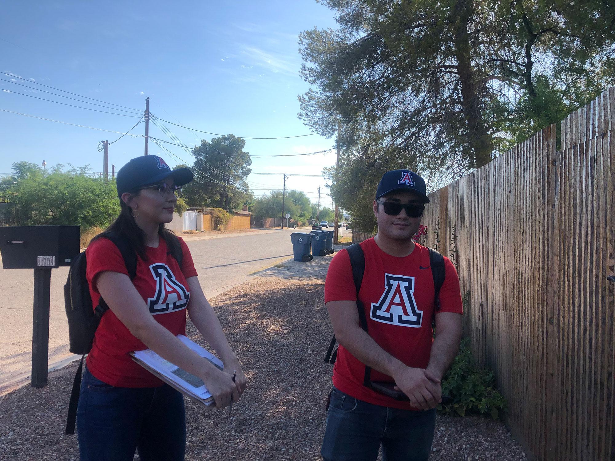 UA students Marisela Trillas and Alan Barcelo take surveys to homes near Rillito River Park.